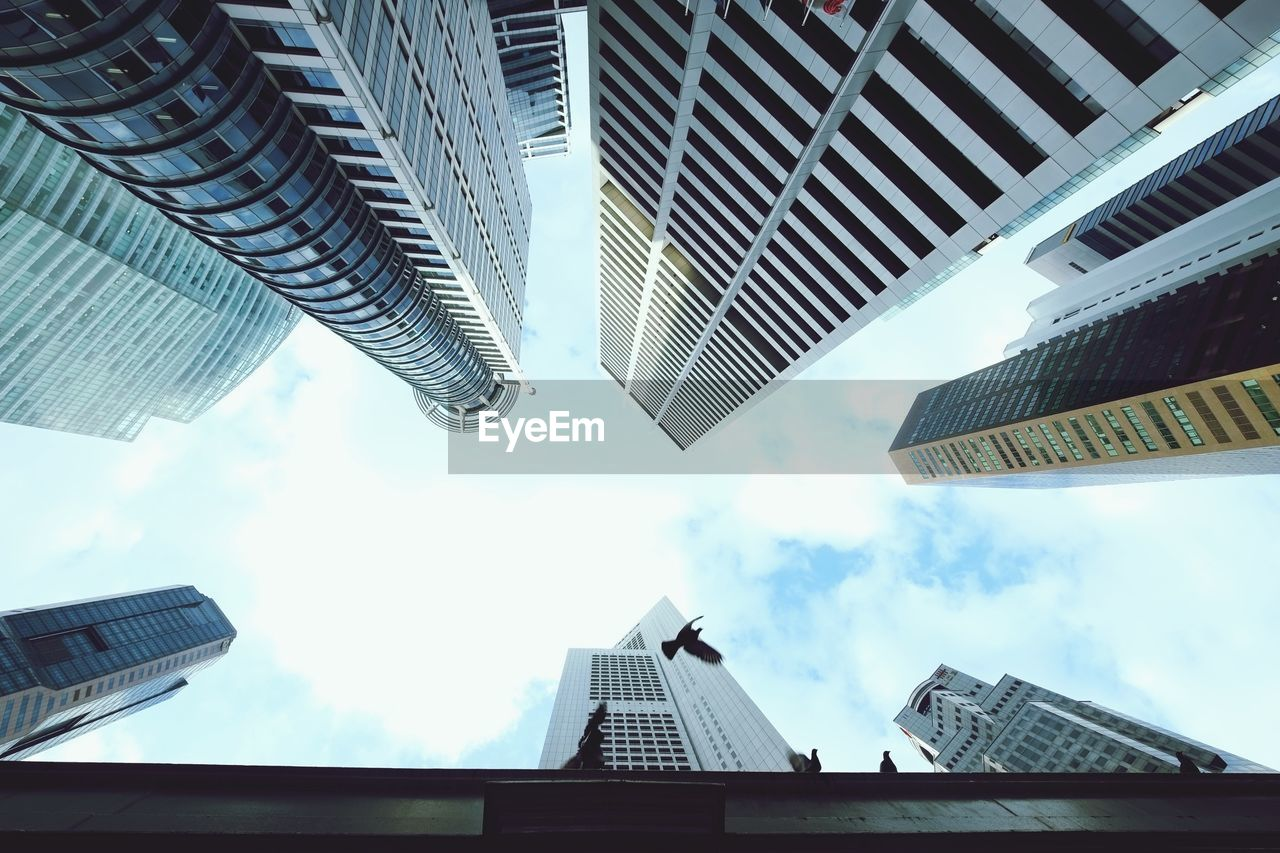 architecture, building exterior, skyscraper, built structure, city, sky, modern, low angle view, outdoors, no people, day, cityscape