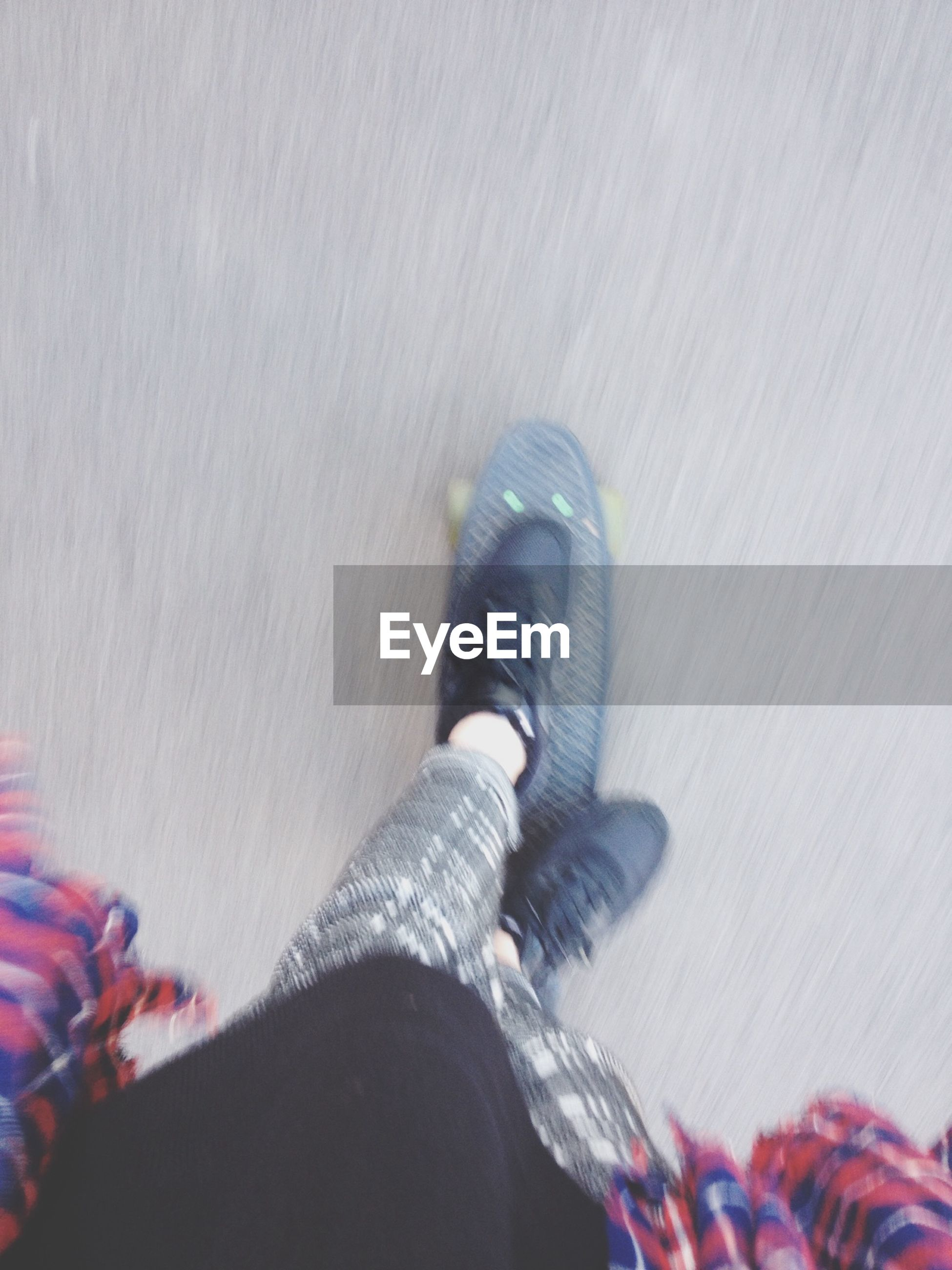 low section, person, lifestyles, shoe, indoors, personal perspective, leisure activity, standing, human foot, high angle view, footwear, casual clothing, jeans, flooring, men, selective focus