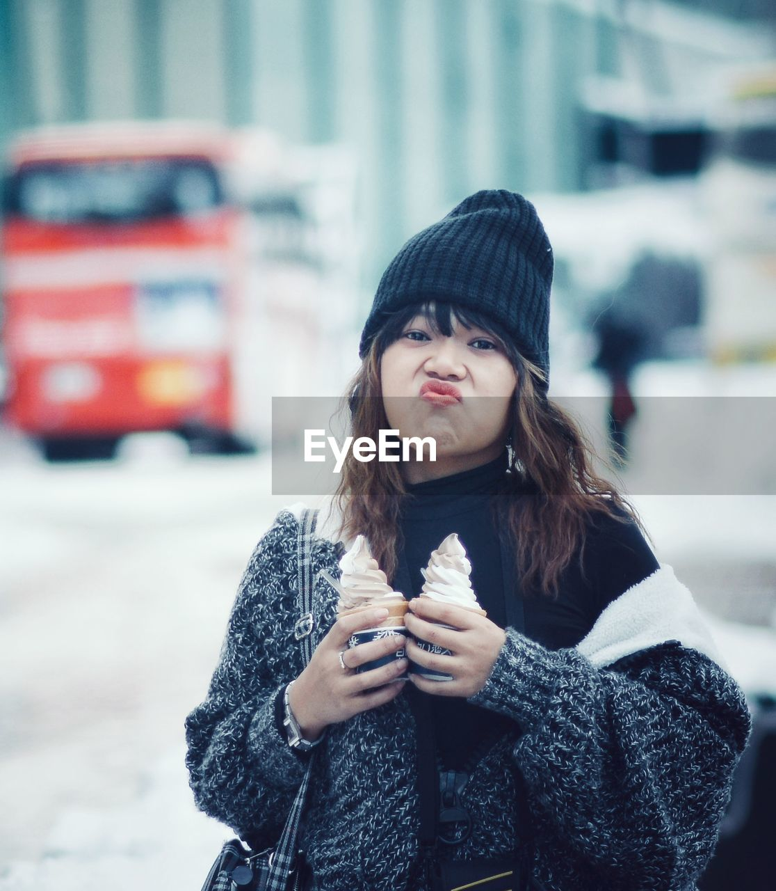 Portrait Of Girl Holding Ice Creams