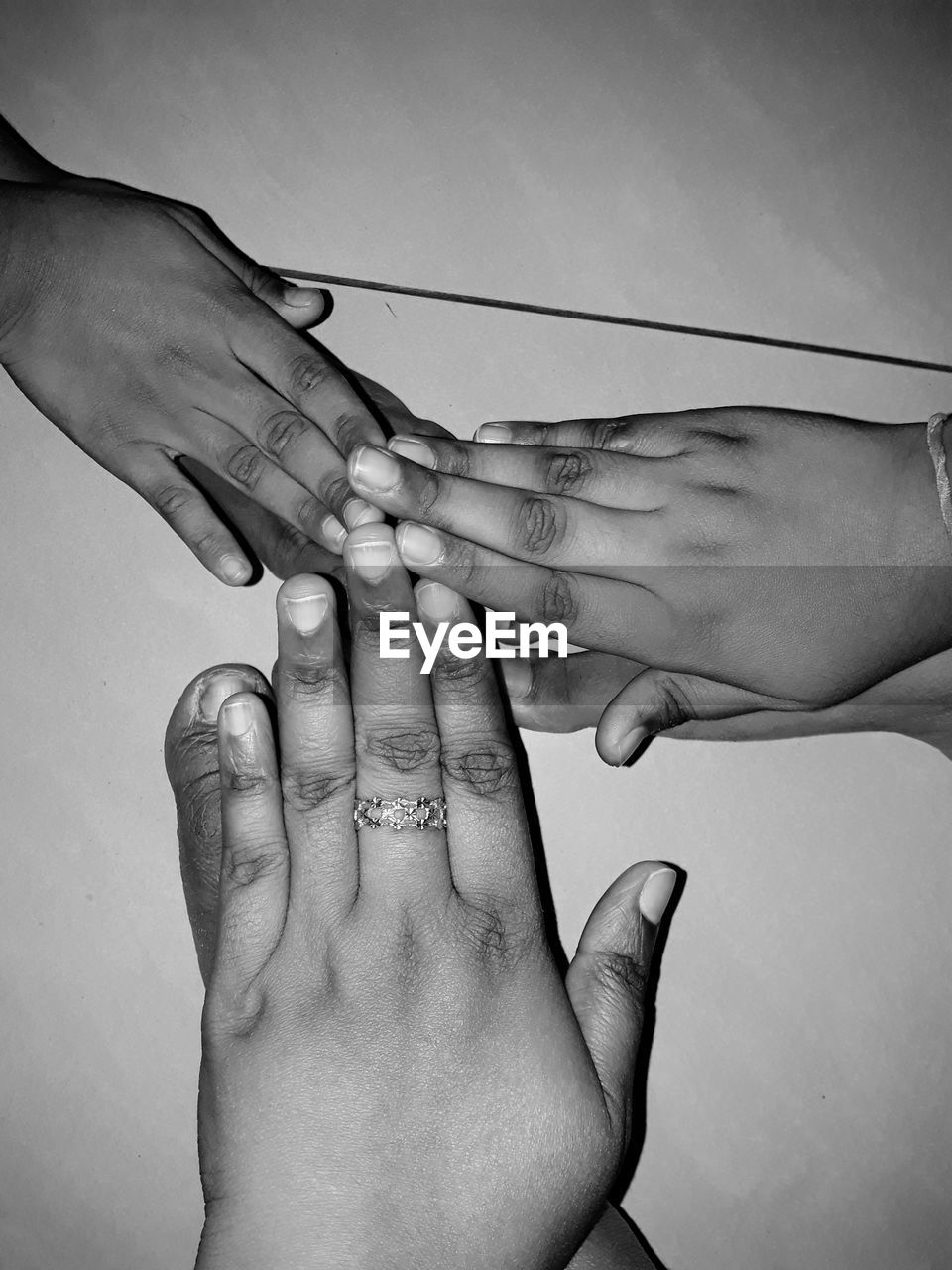 human hand, human body part, togetherness, bonding, connection, men, human finger, unity, touching, three people, love, father, real people, childhood, family, close-up, care, friendship, teamwork, day, outdoors, adult, people