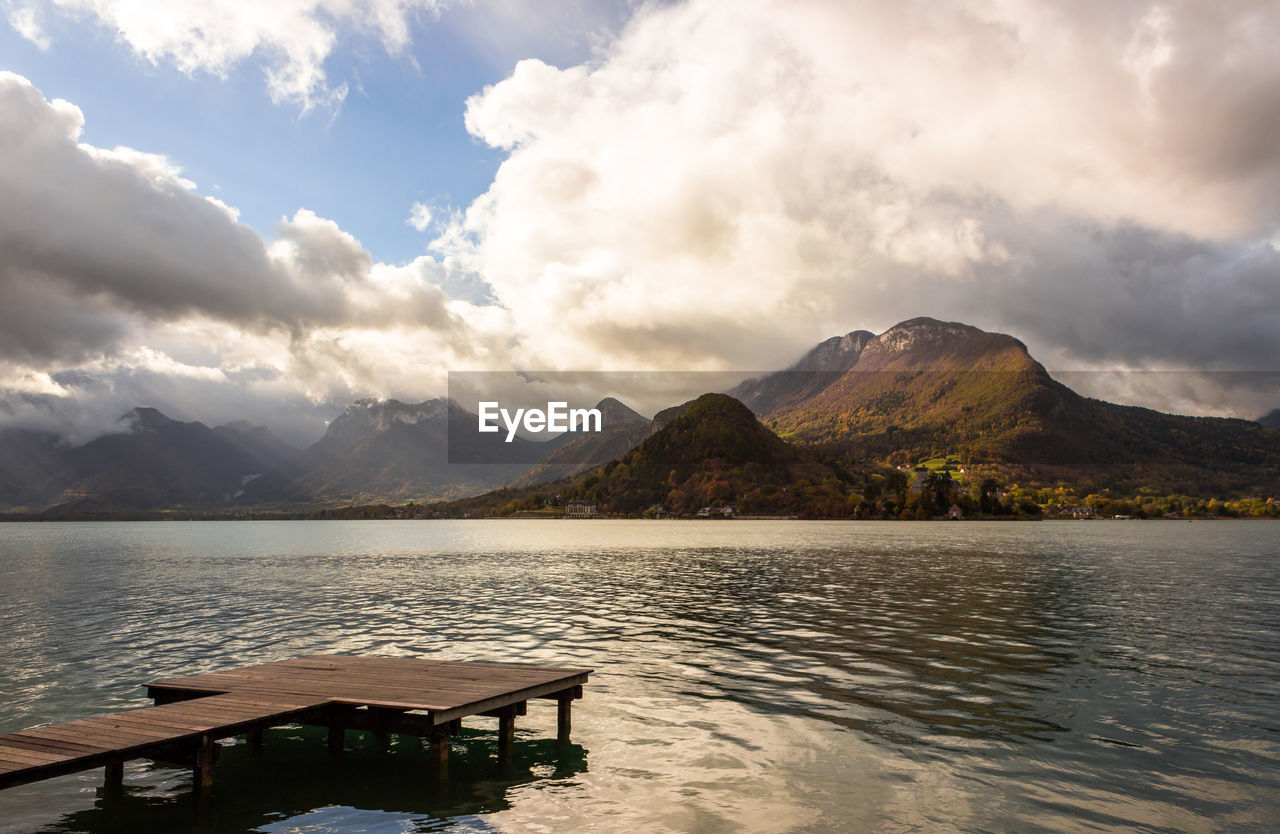 water, mountain, sky, cloud - sky, beauty in nature, lake, tranquility, scenics - nature, tranquil scene, nature, mountain range, idyllic, waterfront, seat, no people, outdoors, non-urban scene, day, remote