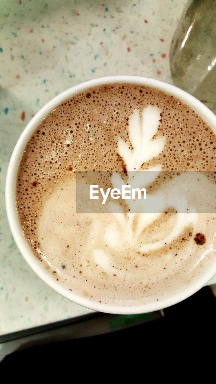 coffee cup, coffee - drink, frothy drink, drink, food and drink, refreshment, cappuccino, indoors, close-up, table, froth art, no people, freshness, high angle view, froth, latte, saucer, directly above, day