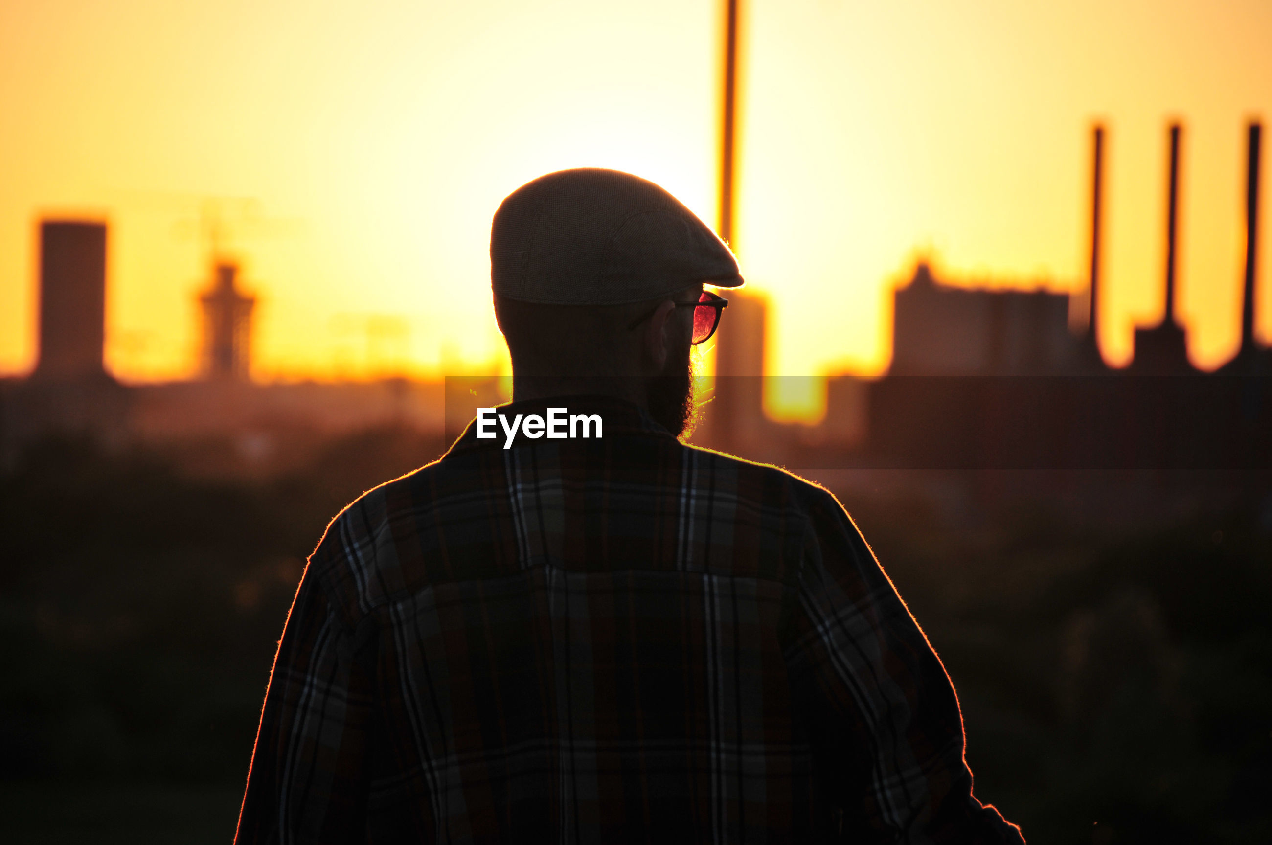 Young man looking into the sunset.