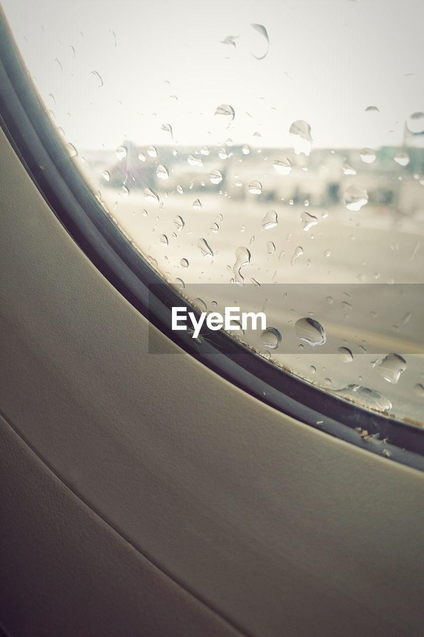 drop, glass - material, water, window, wet, transparent, no people, air vehicle, mode of transportation, close-up, airplane, rain, sky, indoors, nature, transportation, vehicle interior, day, glass, raindrop, rainy season