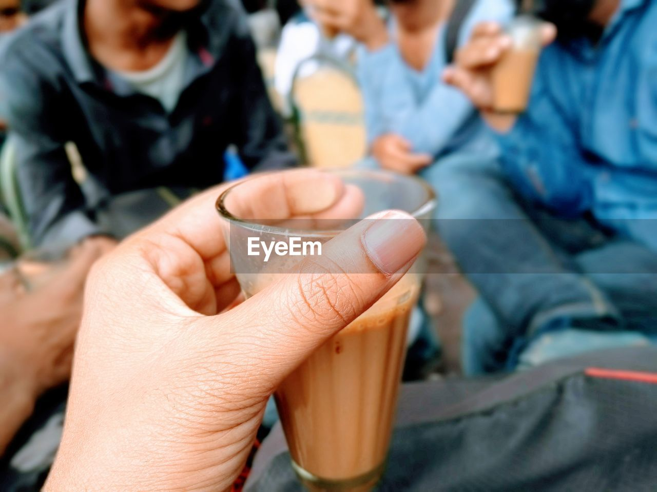 Midsection of people holding drink