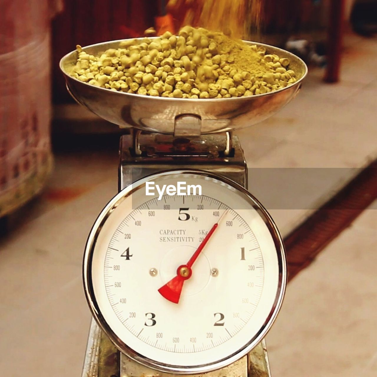 Close-Up Of Hops On Weight Scale In Brewery