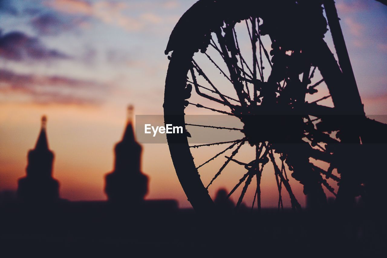 Close-Up Of Silhouette Bicycle Wheel Against The Sky