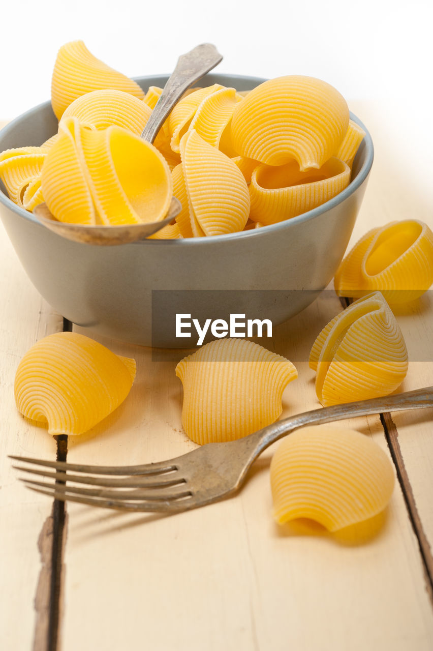 Conchiglies In Bowl On Table