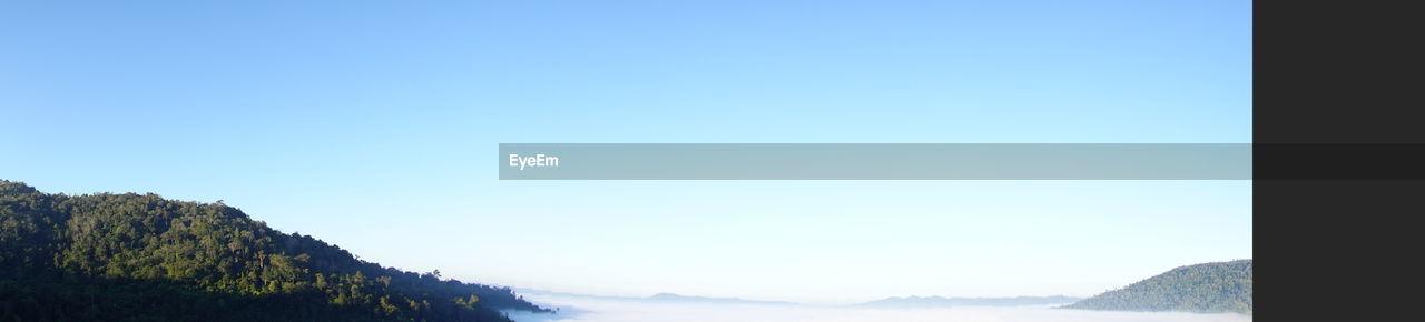 MOUNTAIN RANGE AGAINST CLEAR BLUE SKY