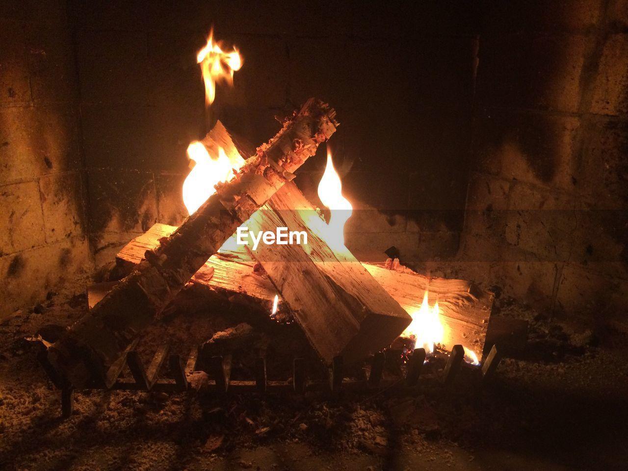 Close-up of logs burning