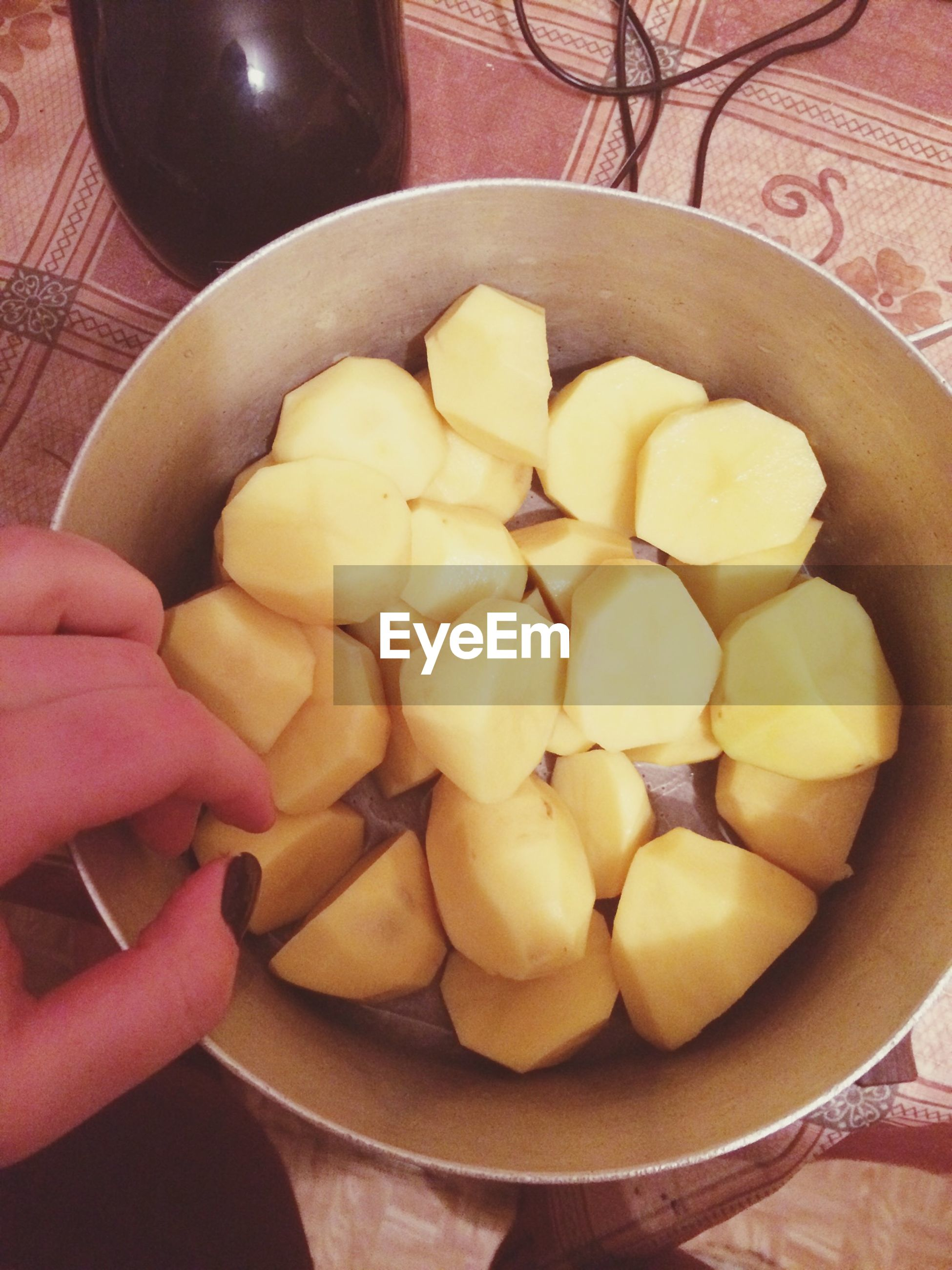 food and drink, food, freshness, person, healthy eating, indoors, holding, fruit, cropped, high angle view, unrecognizable person, part of, lifestyles, bowl, table, close-up, ready-to-eat