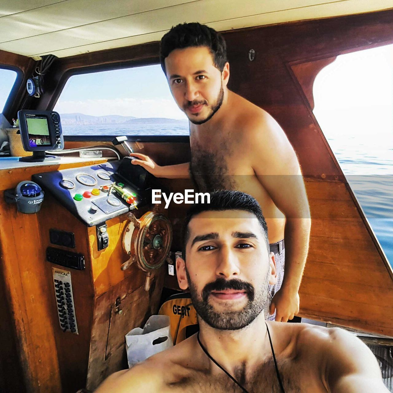 looking at camera, two people, portrait, young adult, real people, young men, shirtless, leisure activity, mid adult men, transportation, love, day, lifestyles, beard, nautical vessel, togetherness, happiness, making a face, outdoors, sky, people