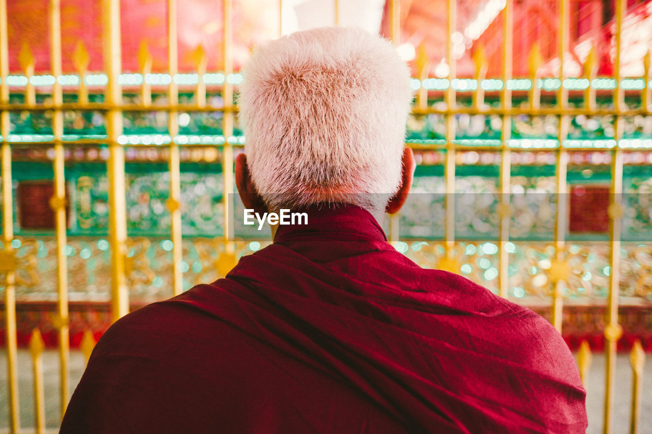 Rear View Of Senior Buddhist Monk