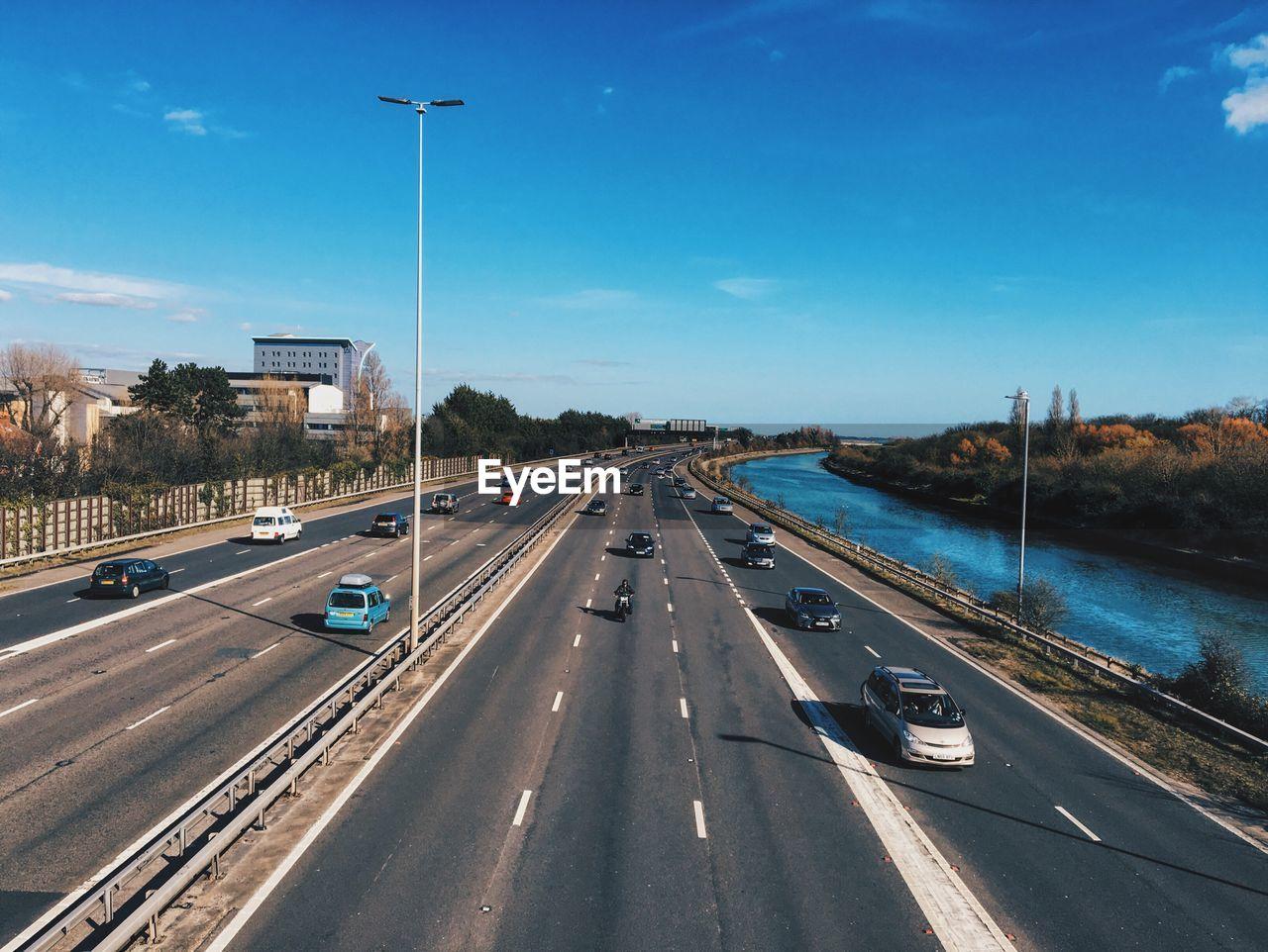 Road Passing Through City Against Sky