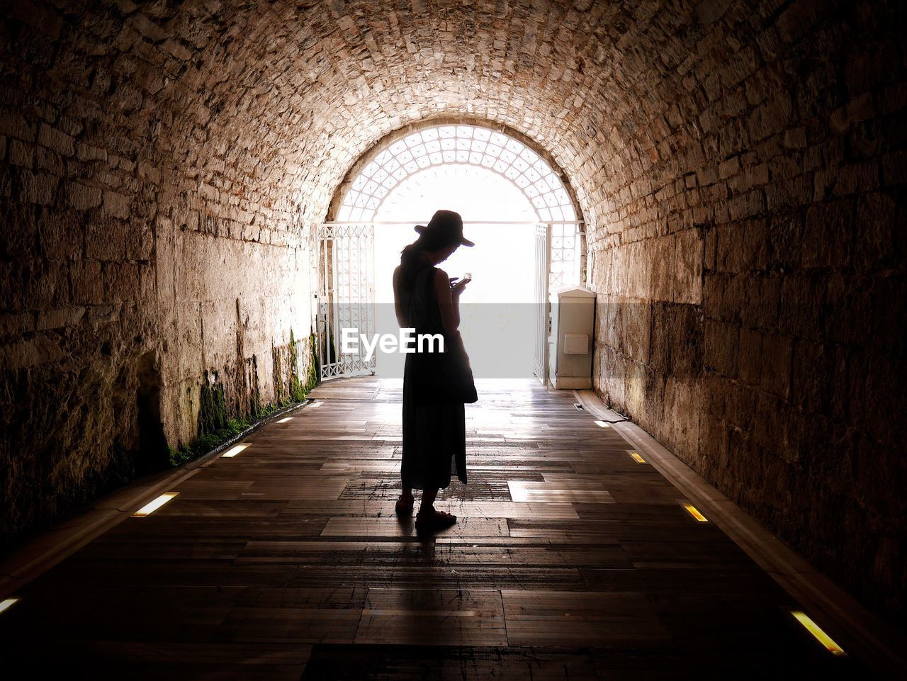 Woman Standing In An Old Tunnel