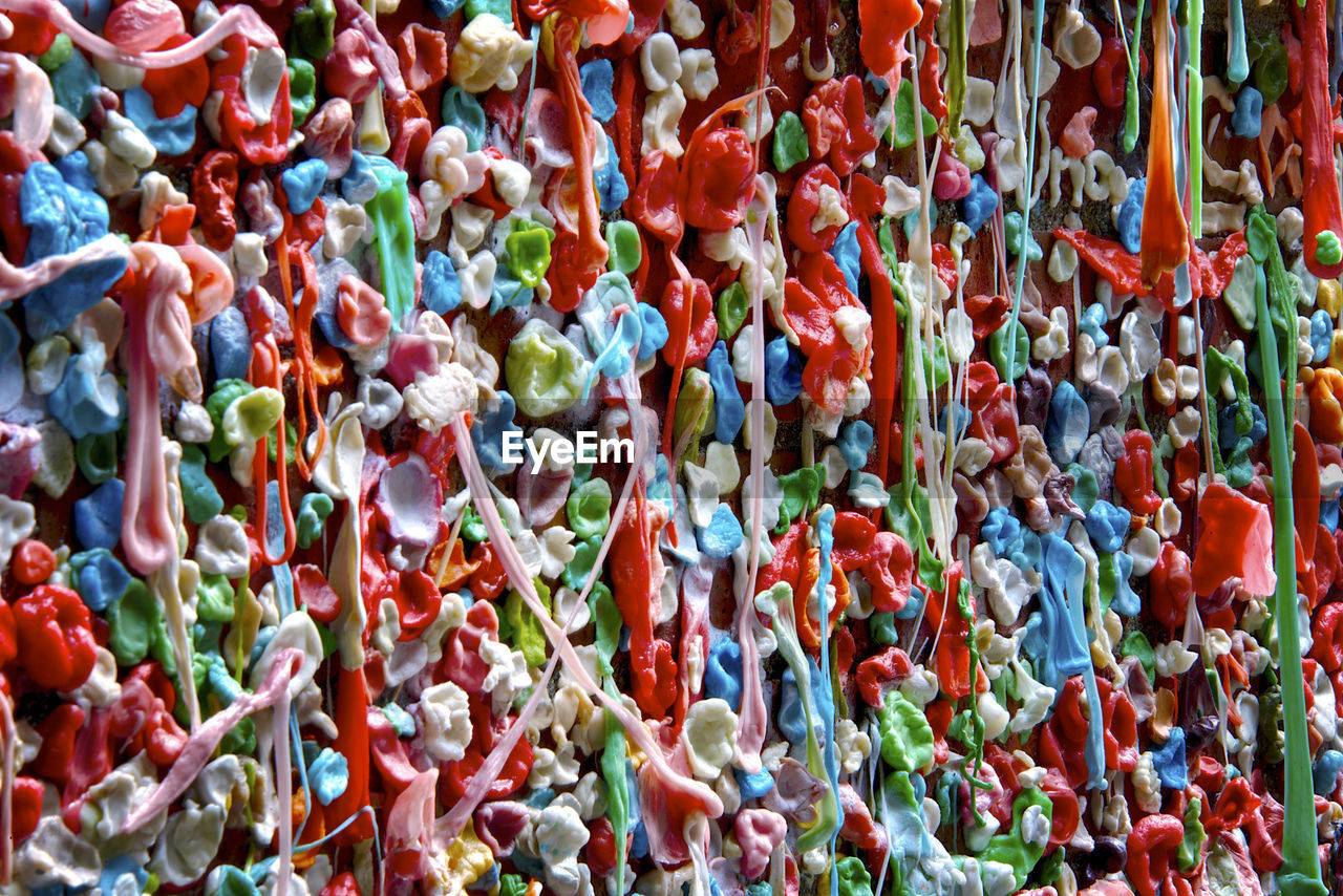 Full frame shot of multi colored chewing gum hanging at market