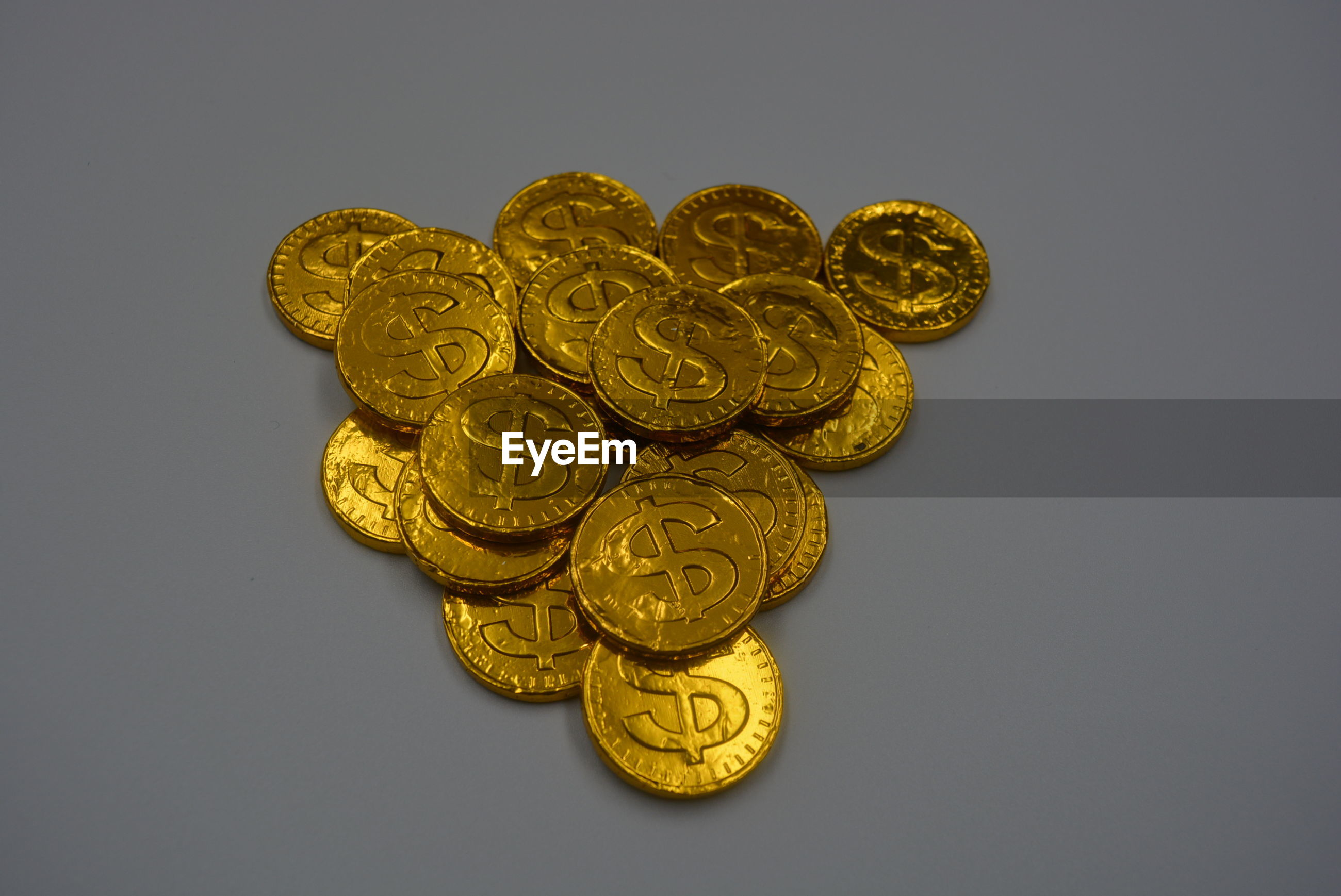 High angle view of coins on gray background