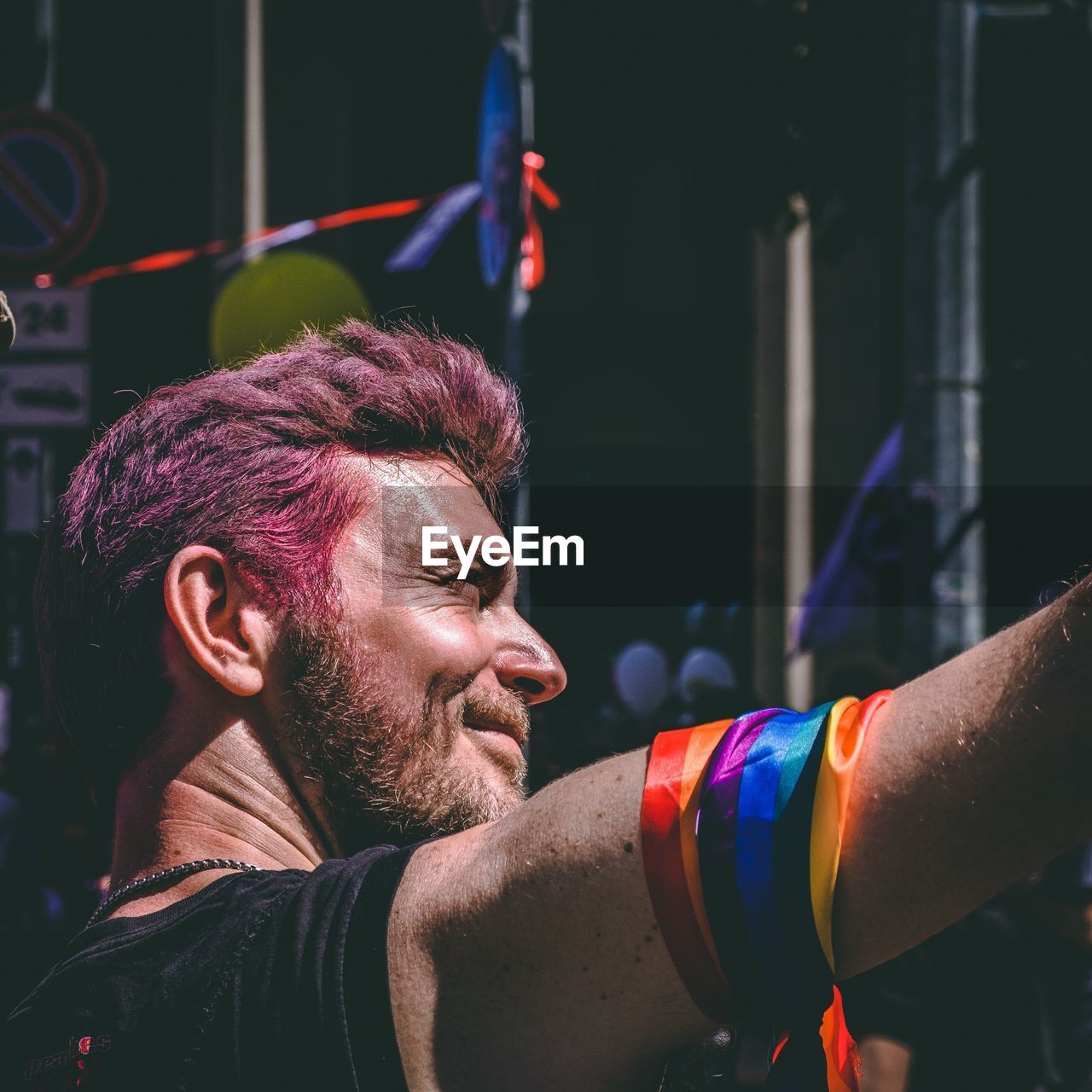 Low Angle View Of Man Wearing Colorful Ribbons During Gay Parade