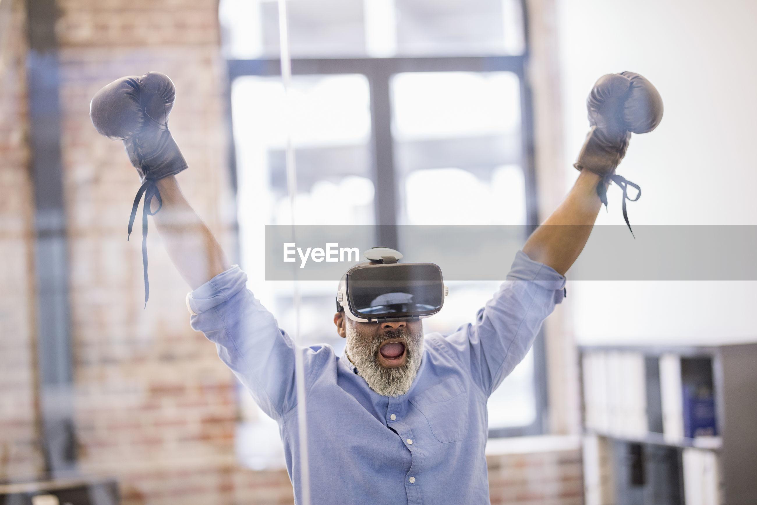 FULL LENGTH PORTRAIT OF MAN STANDING AGAINST WALL