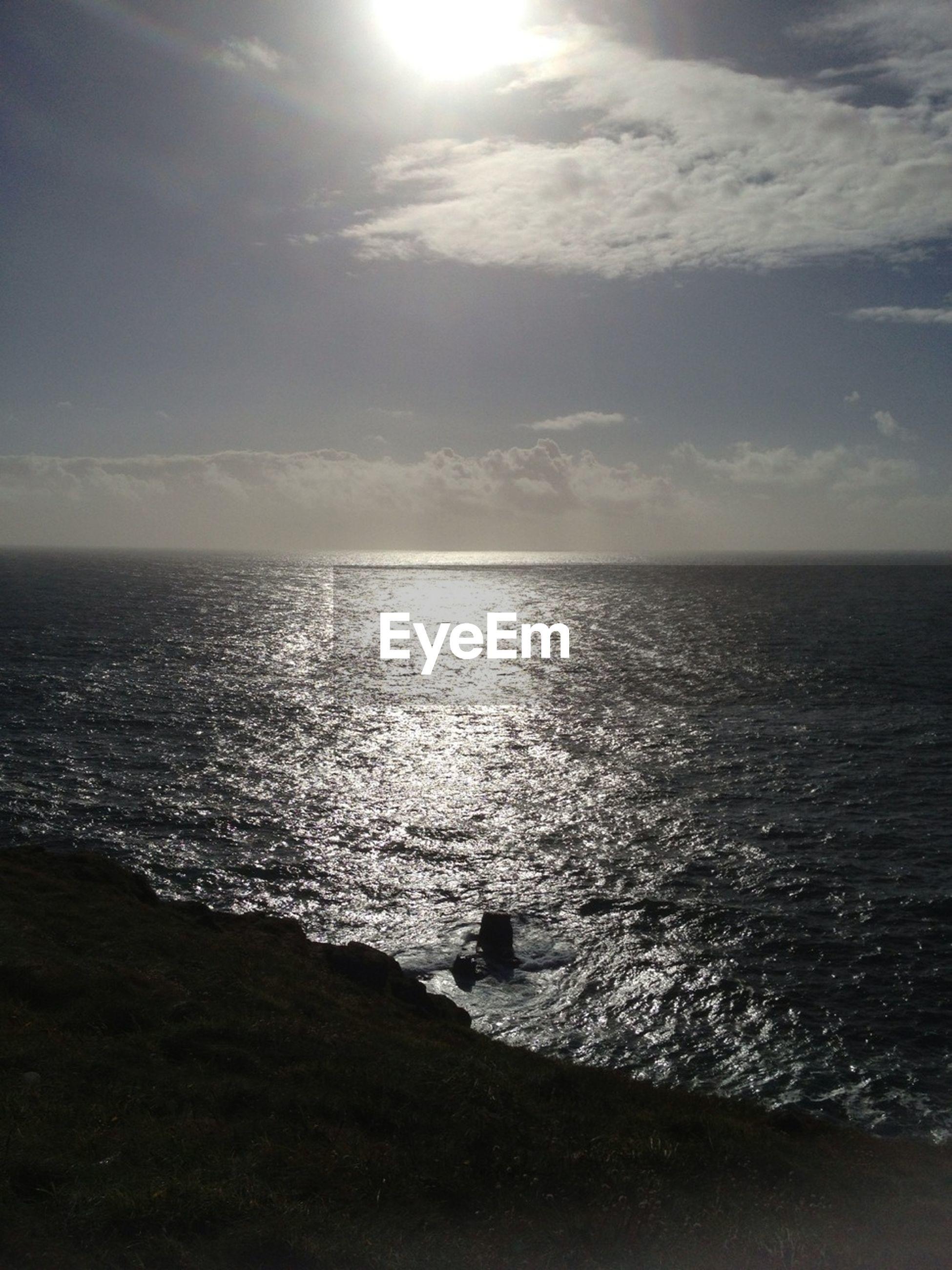 sea, horizon over water, water, tranquil scene, scenics, tranquility, sky, beauty in nature, sun, nature, idyllic, reflection, seascape, beach, sunset, cloud - sky, sunlight, shore, rippled, sunbeam