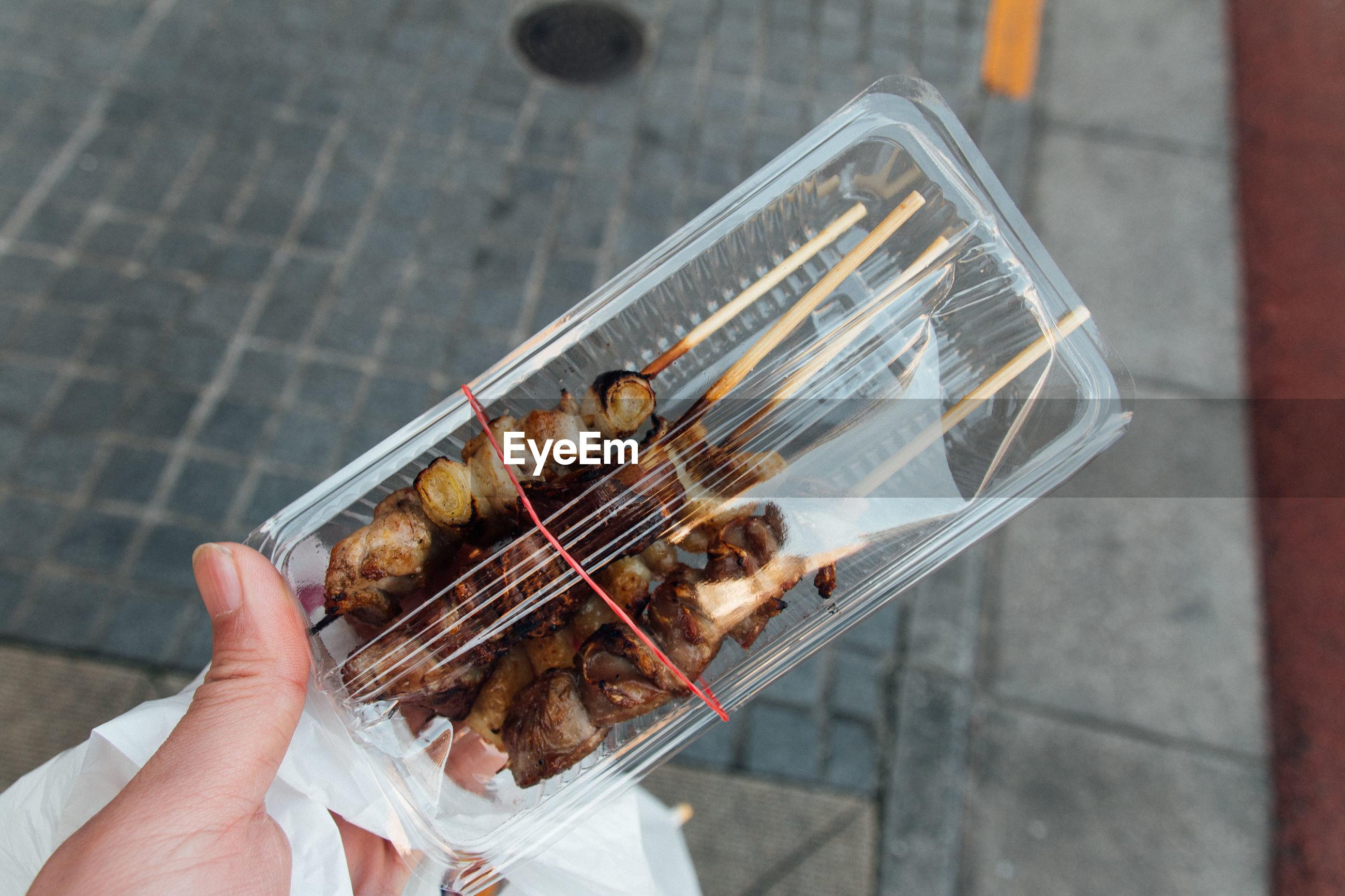 Close-up of hand holding yukiyori in japan
