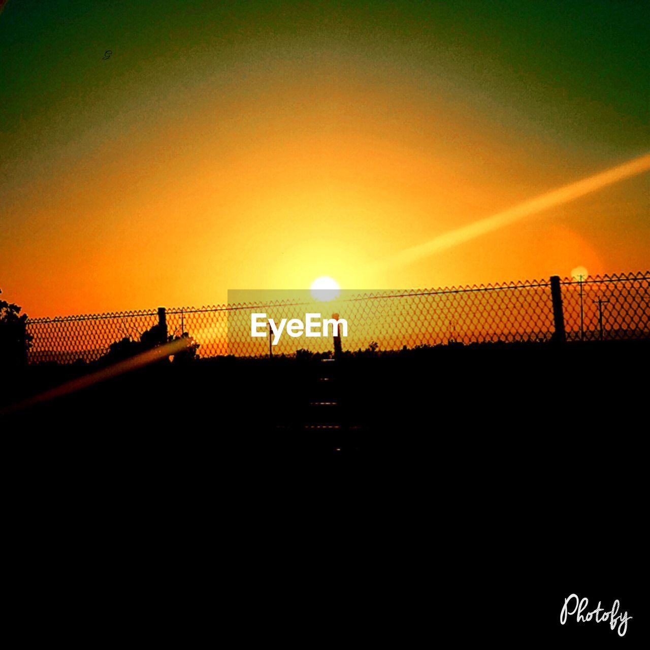 sunset, silhouette, orange color, sun, nature, scenics, sky, beauty in nature, outdoors, sunlight, no people, water, day