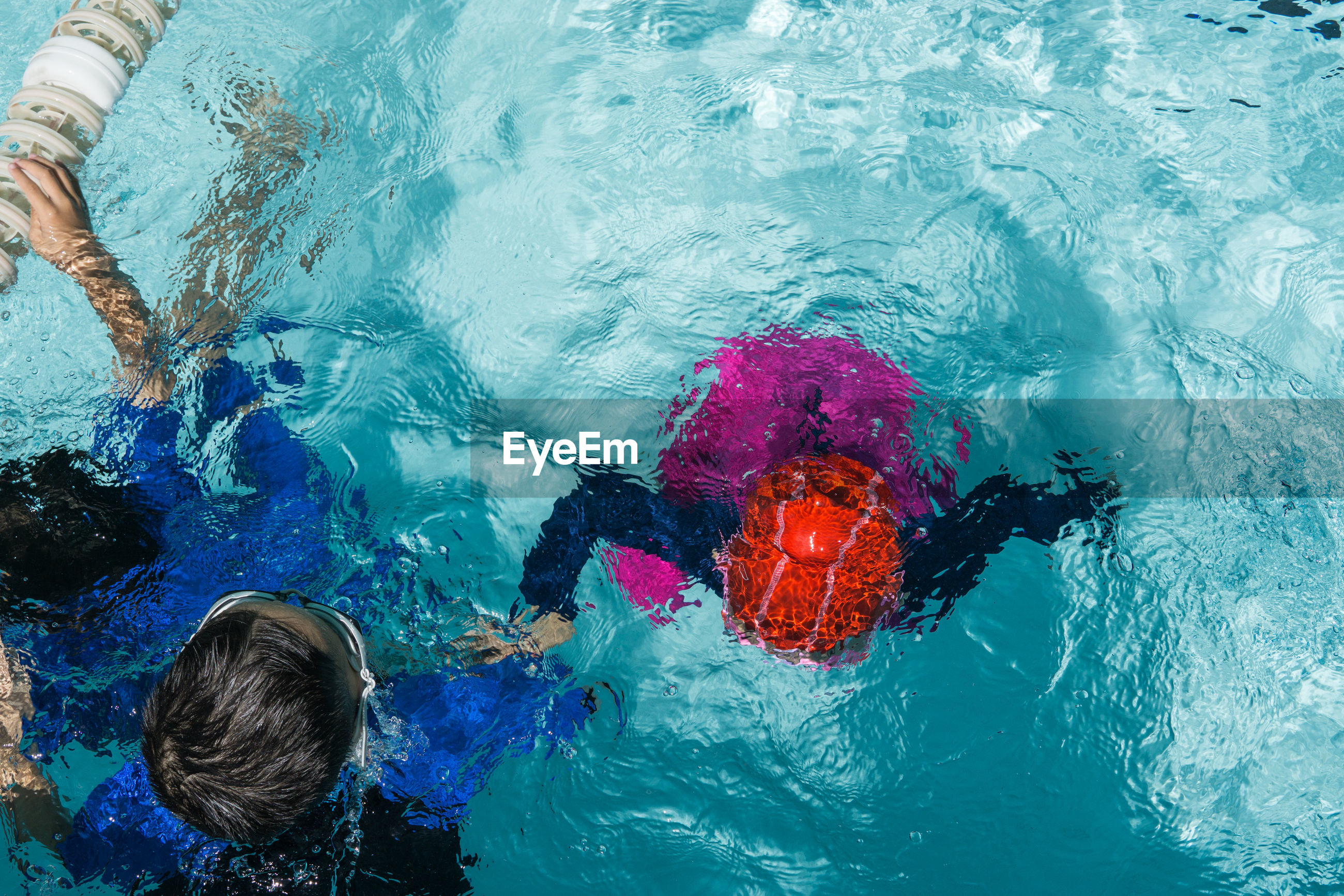 High angle view of kids swimming in pool