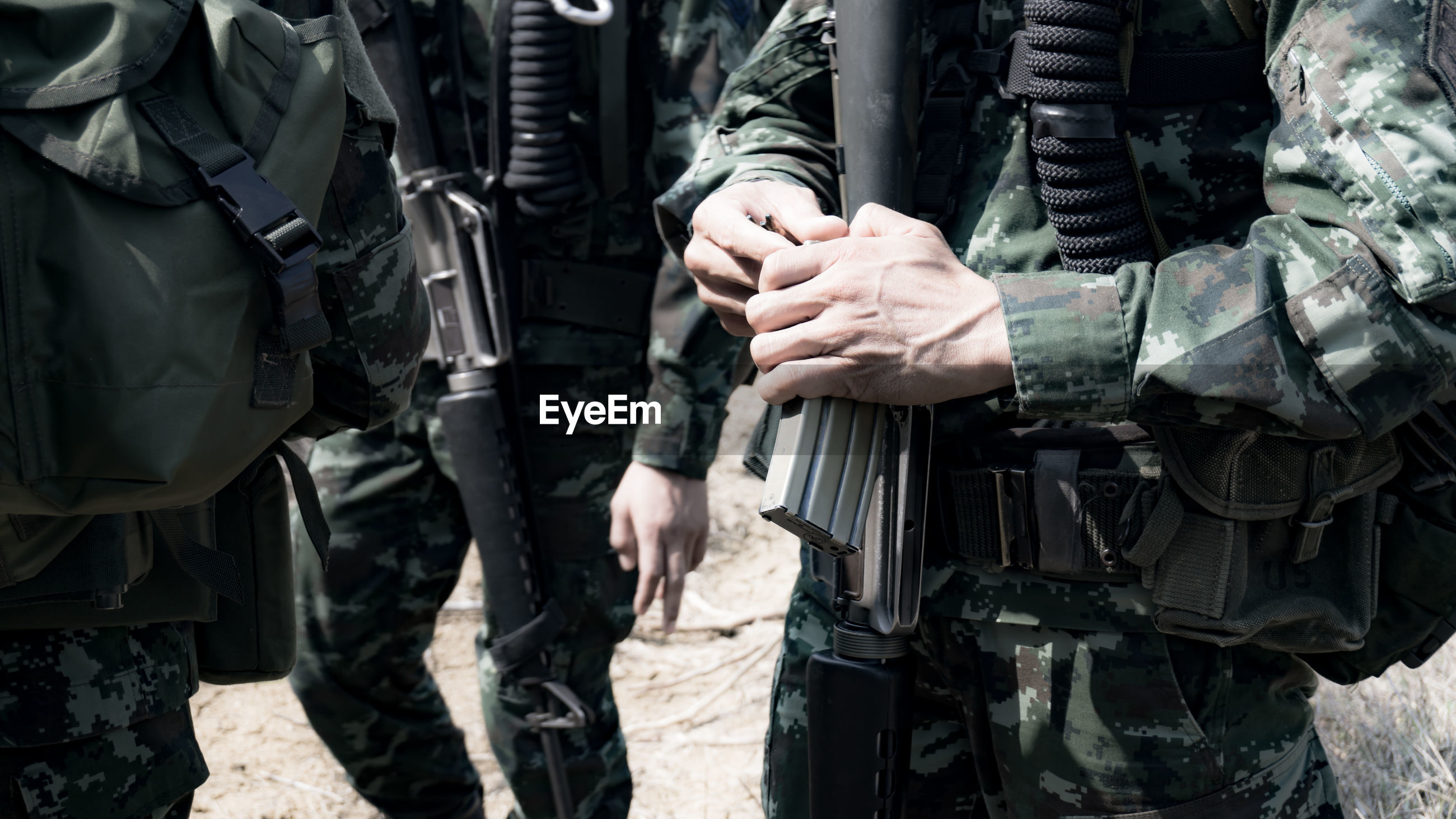 Close-up of army soldiers with rifle