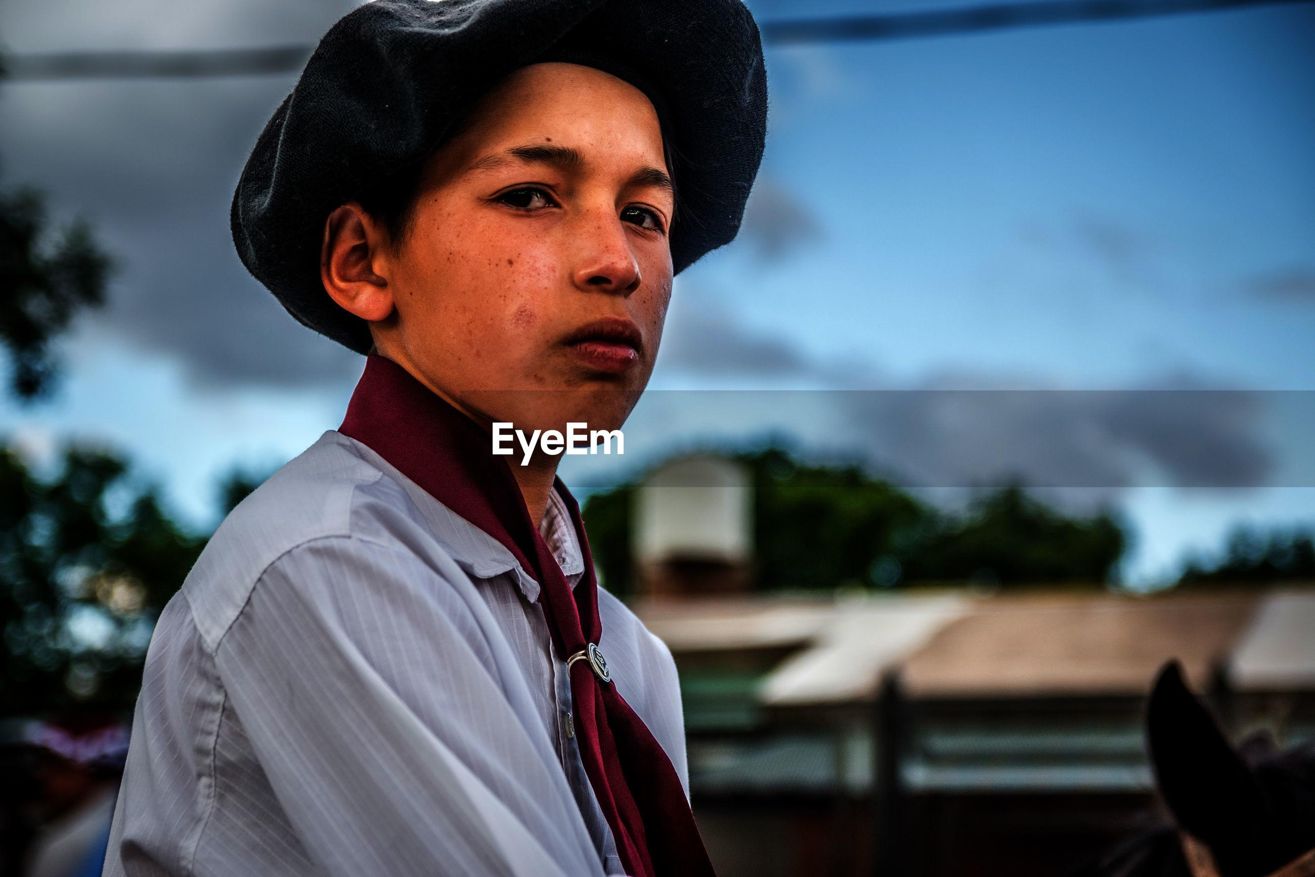 Portrait of teenage boy wearing uniform