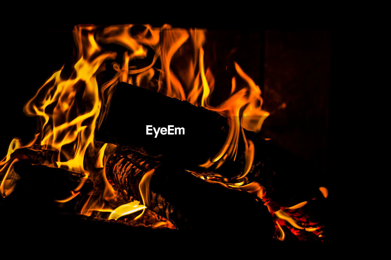 flame, burning, heat - temperature, orange color, night, glowing, no people, close-up, motion, bonfire, long exposure, outdoors