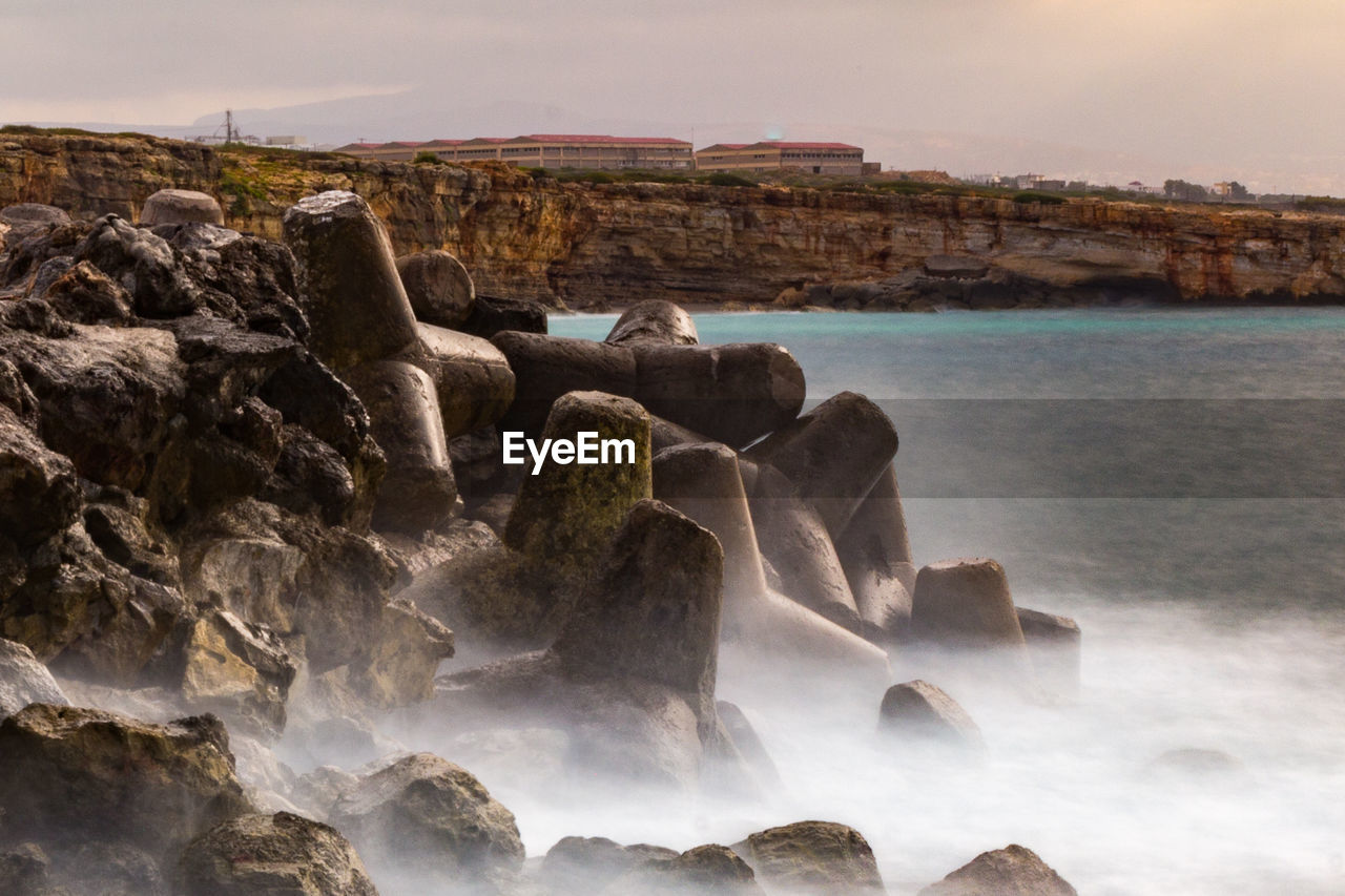 rock, water, sea, rock - object, solid, beauty in nature, scenics - nature, sky, nature, rock formation, land, motion, beach, no people, tranquility, long exposure, tranquil scene, non-urban scene, day, outdoors, power in nature, flowing water, rocky coastline, formation