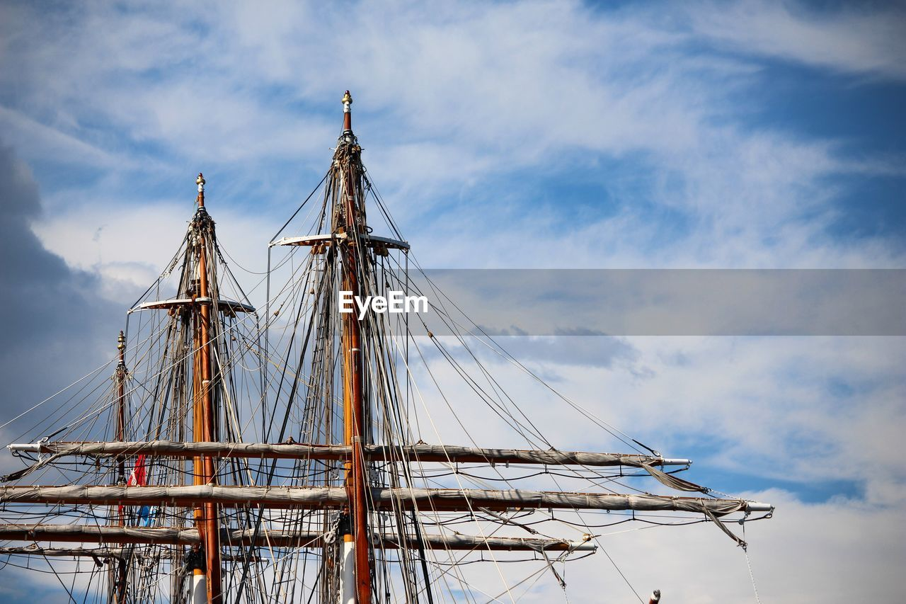 sky, cloud - sky, nautical vessel, sailboat, pole, mast, mode of transportation, ship, nature, no people, day, transportation, low angle view, sailing ship, outdoors, sailing, sea, travel, water, rope, rigging