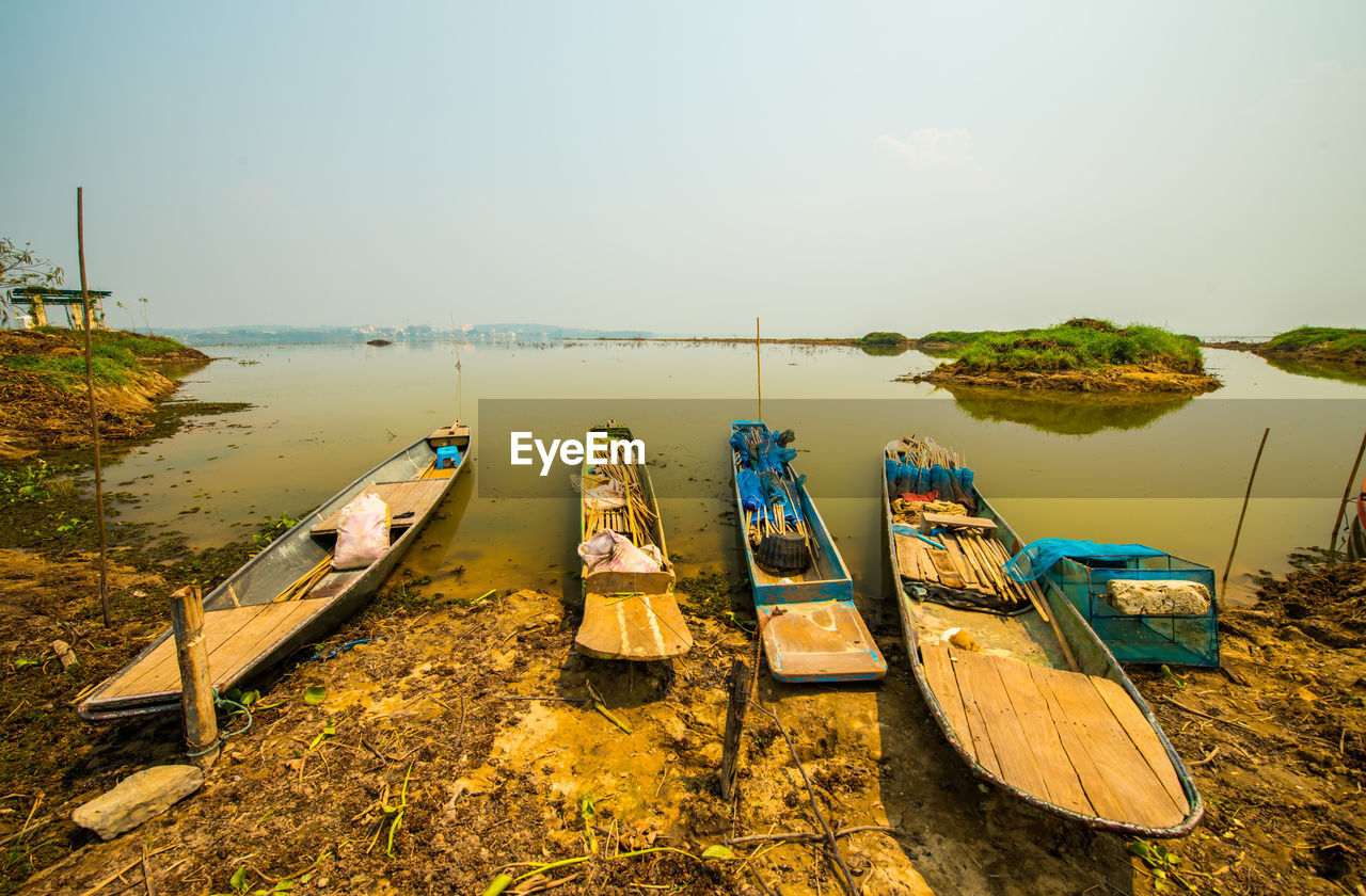 water, nautical vessel, sky, transportation, mode of transportation, nature, moored, tranquility, beauty in nature, no people, scenics - nature, tranquil scene, day, sea, beach, land, non-urban scene, plant, outdoors, rowboat