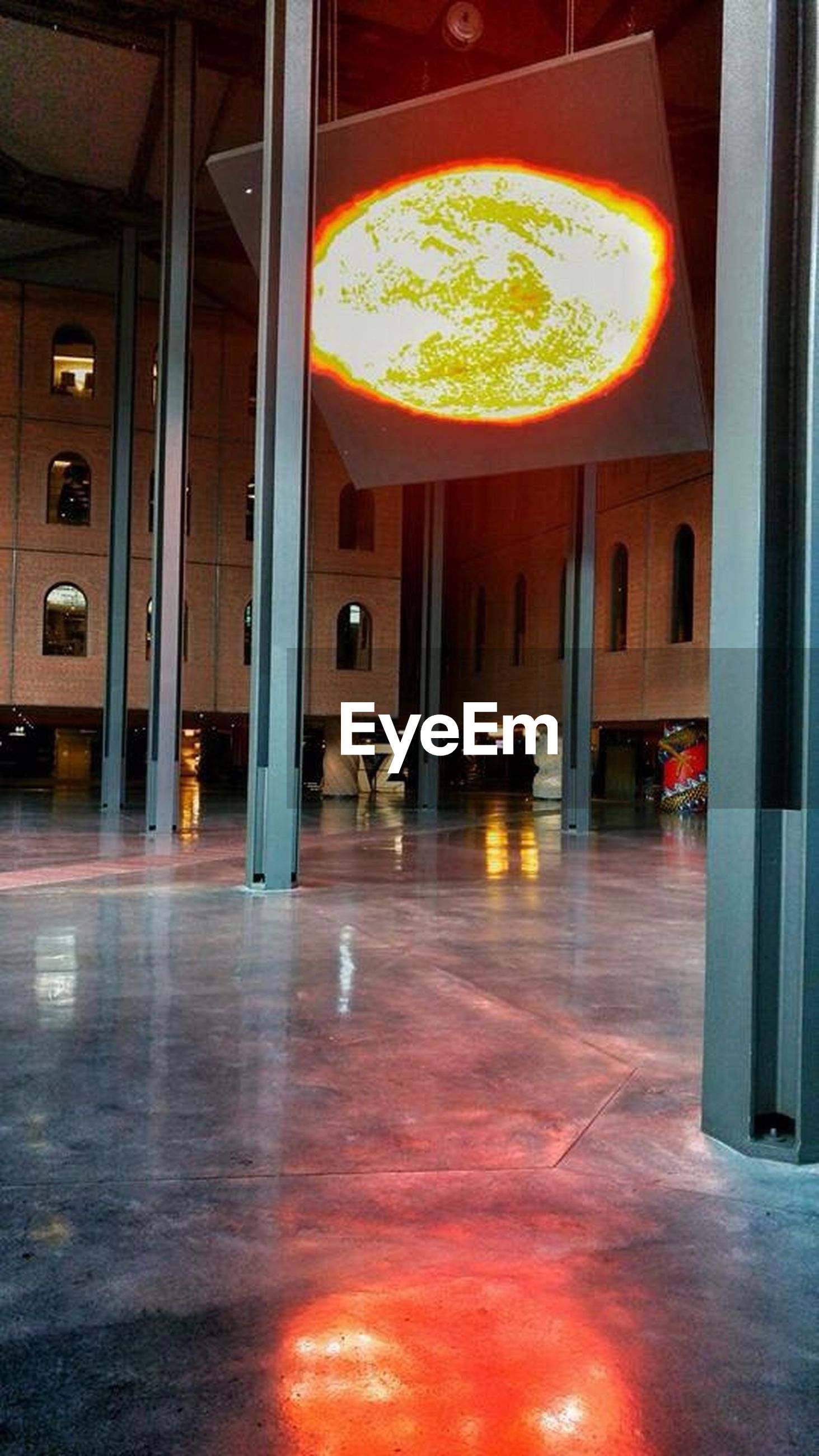 indoors, illuminated, architecture, built structure, window, reflection, lighting equipment, glass - material, flooring, empty, no people, absence, orange color, architectural column, ceiling, city, tiled floor, interior, night, glowing