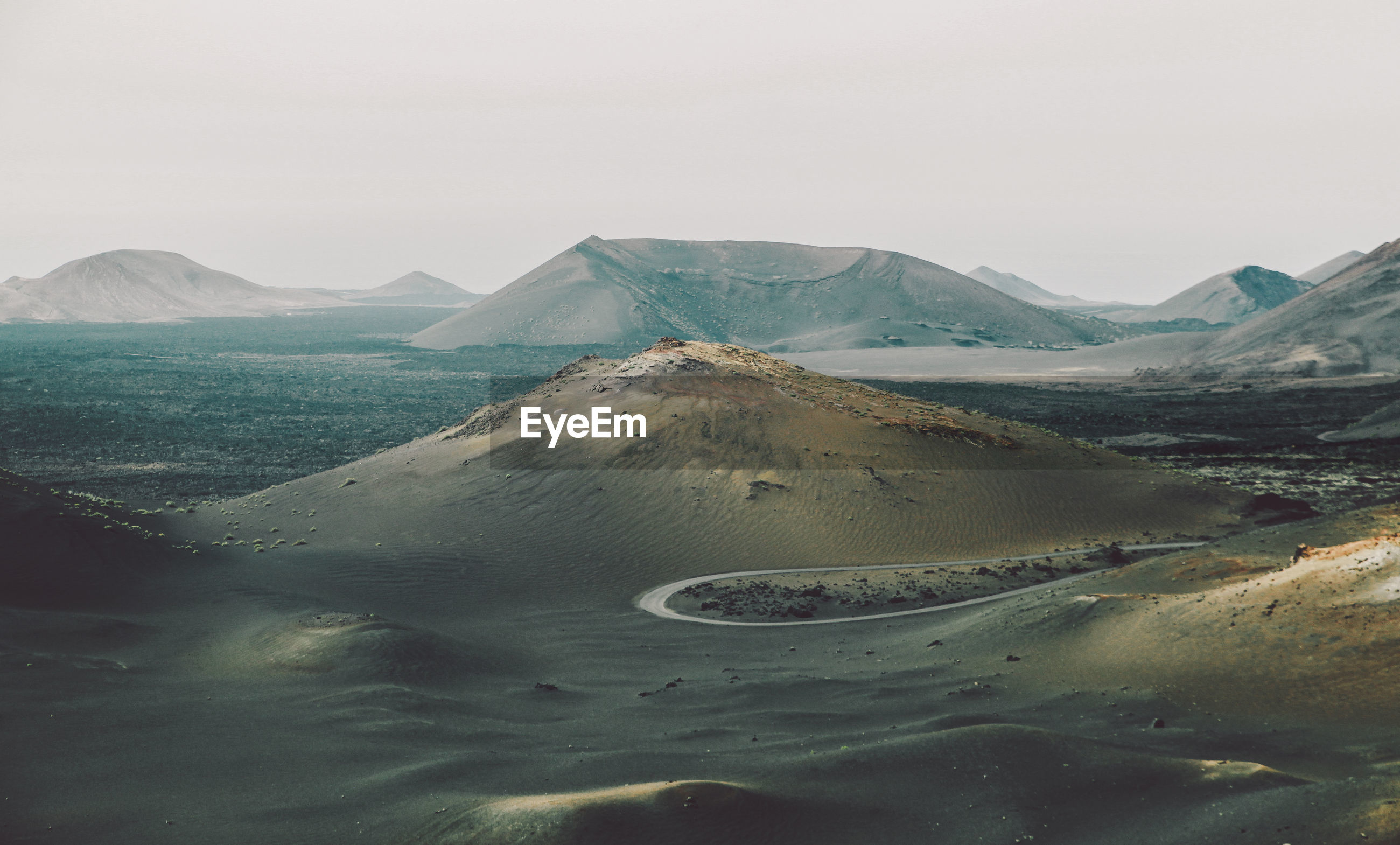 Idyllic shot of landscape at timanfaya national park against clear sky