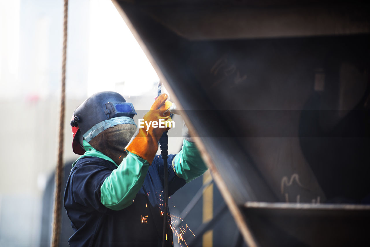 MAN WORKING ON BUS