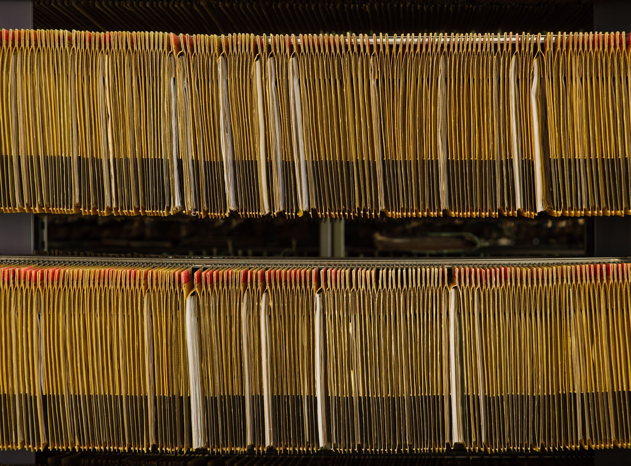 Close-Up Of Records In Shelves