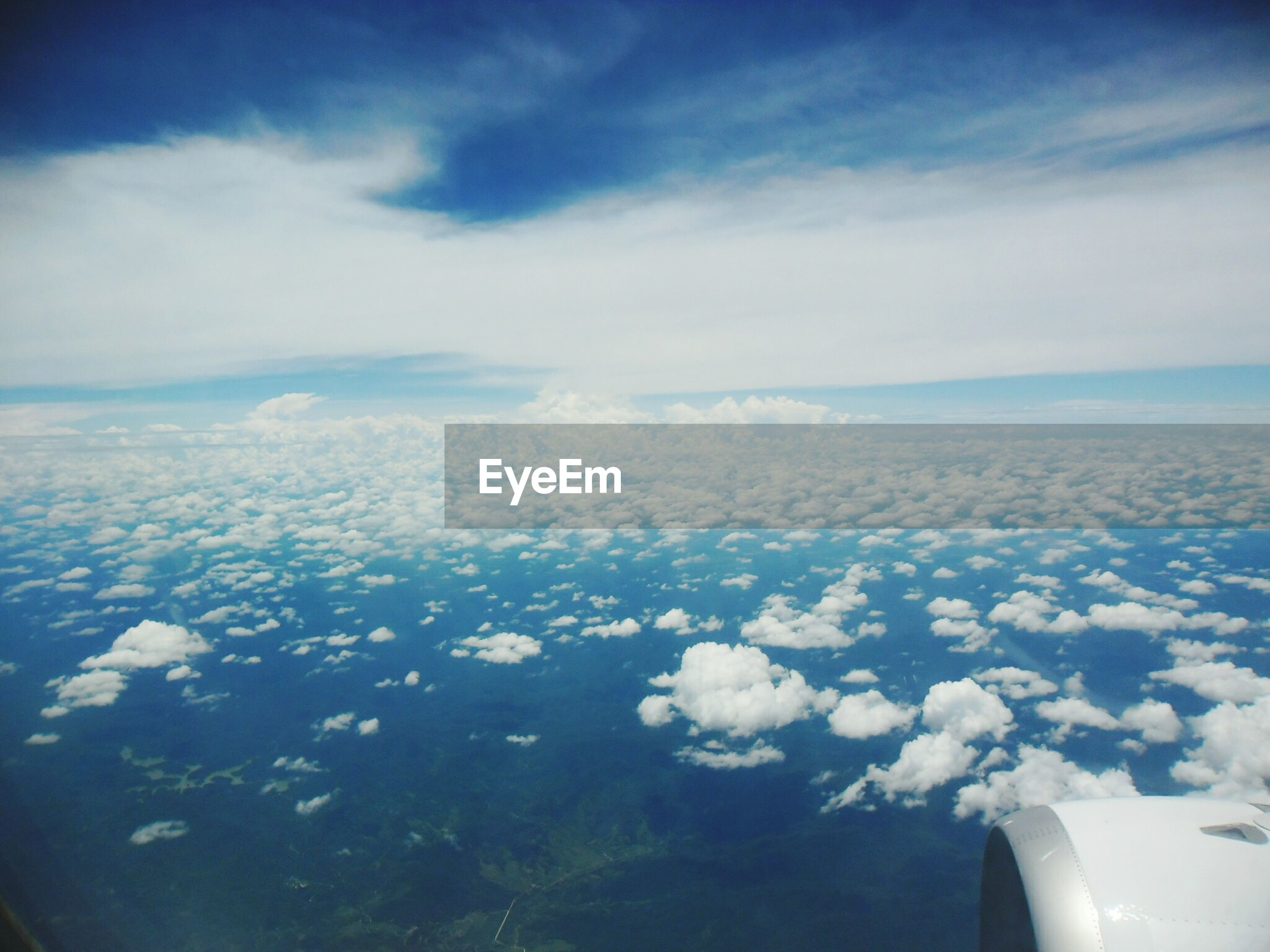 airplane, sky, transportation, mode of transport, air vehicle, aerial view, part of, cropped, blue, beauty in nature, scenics, flying, cloud - sky, aircraft wing, window, nature, vehicle interior, cloudscape, cloud, travel