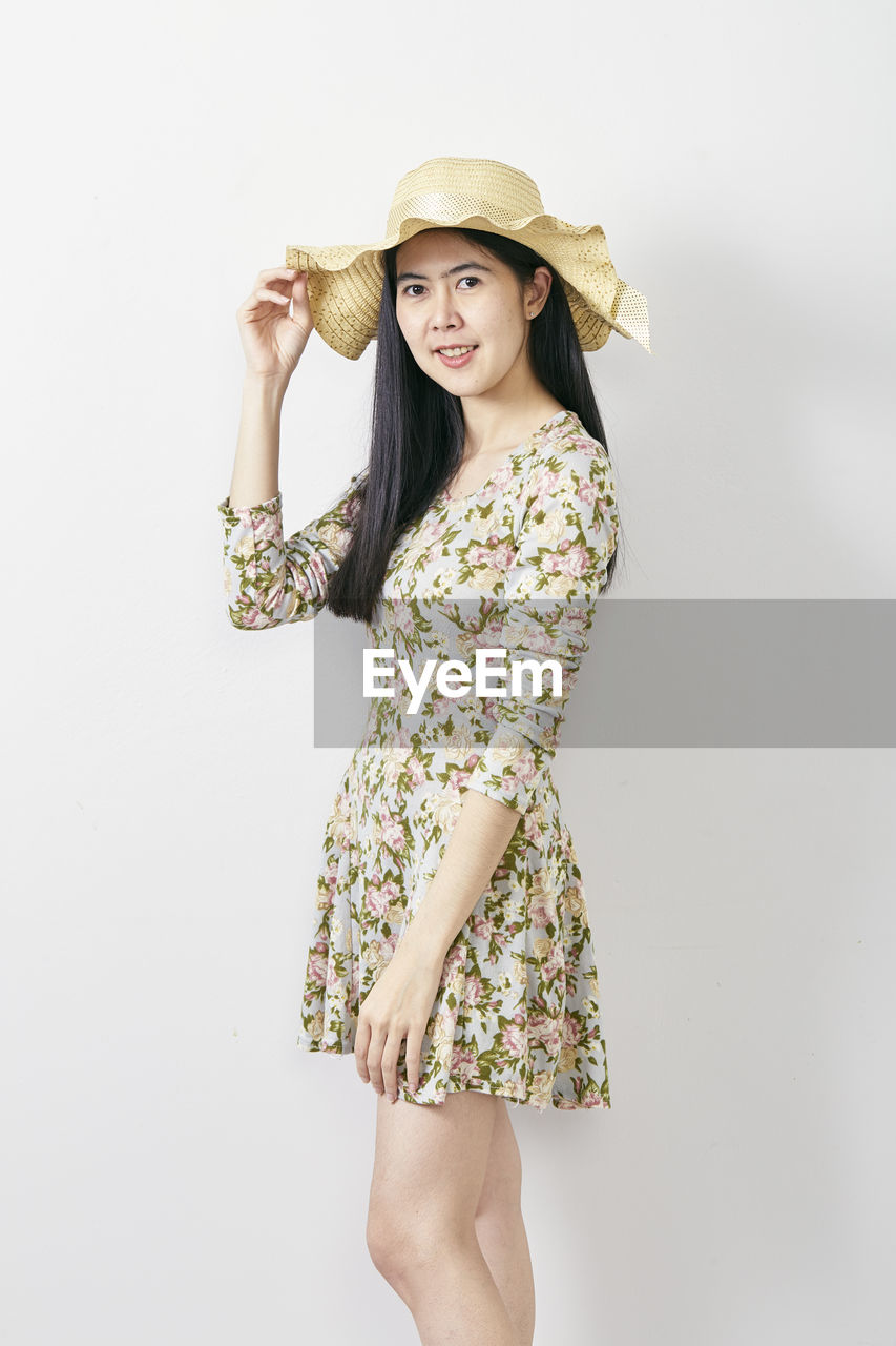 studio shot, white background, hat, young women, indoors, one person, standing, clothing, cut out, young adult, women, smiling, casual clothing, lifestyles, looking at camera, leisure activity, beauty, three quarter length, portrait, fashion, beautiful woman, hair, hairstyle