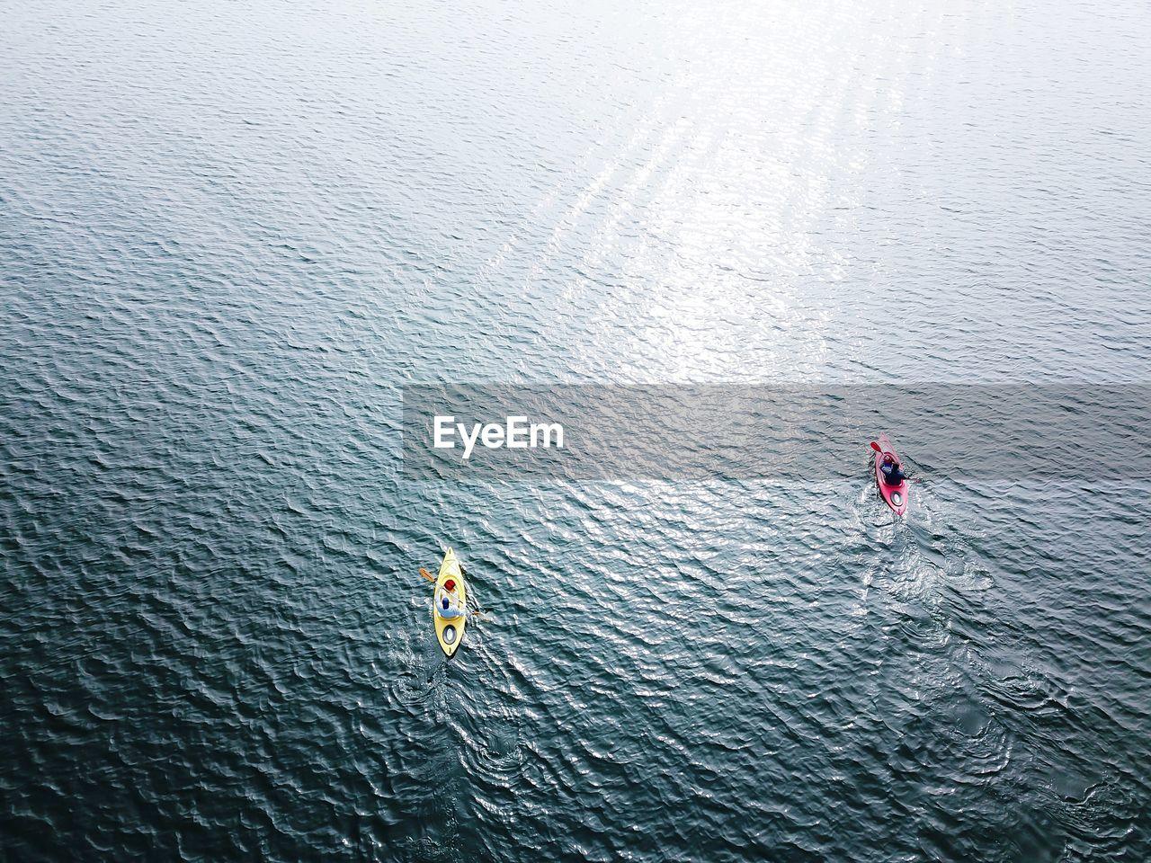 High Angle View Of People Kayaking On Lake
