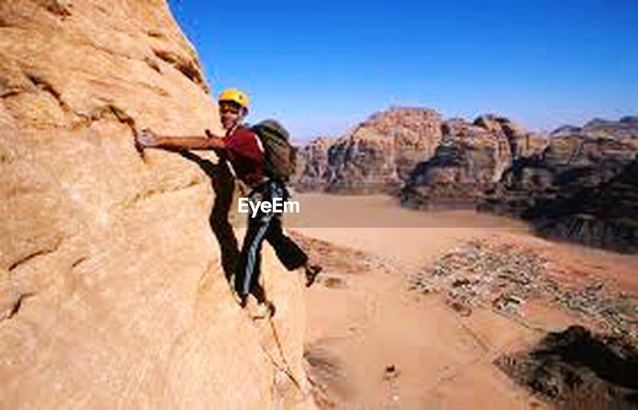 rock - object, adventure, extreme sports, adults only, rock climbing, one person, adult, sport, healthy lifestyle, skill, only women, helmet, vitality, one woman only, outdoors, cliff, challenge, sports clothing, sports helmet, headwear, people, climbing, nature, day, sky