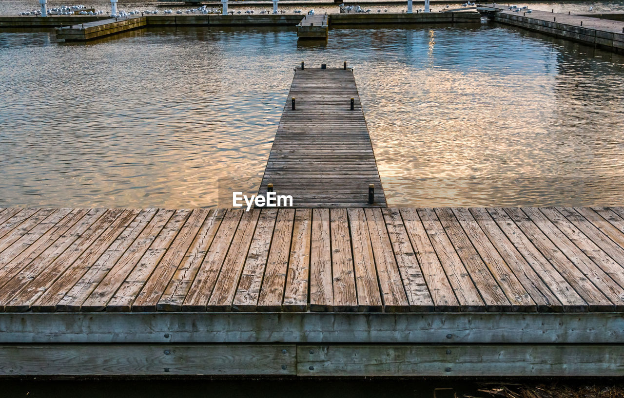 water, architecture, built structure, wood - material, no people, day, pier, nature, bridge, connection, outdoors, lake, building exterior, direction, the way forward, transportation, high angle view, footpath, long, wood paneling