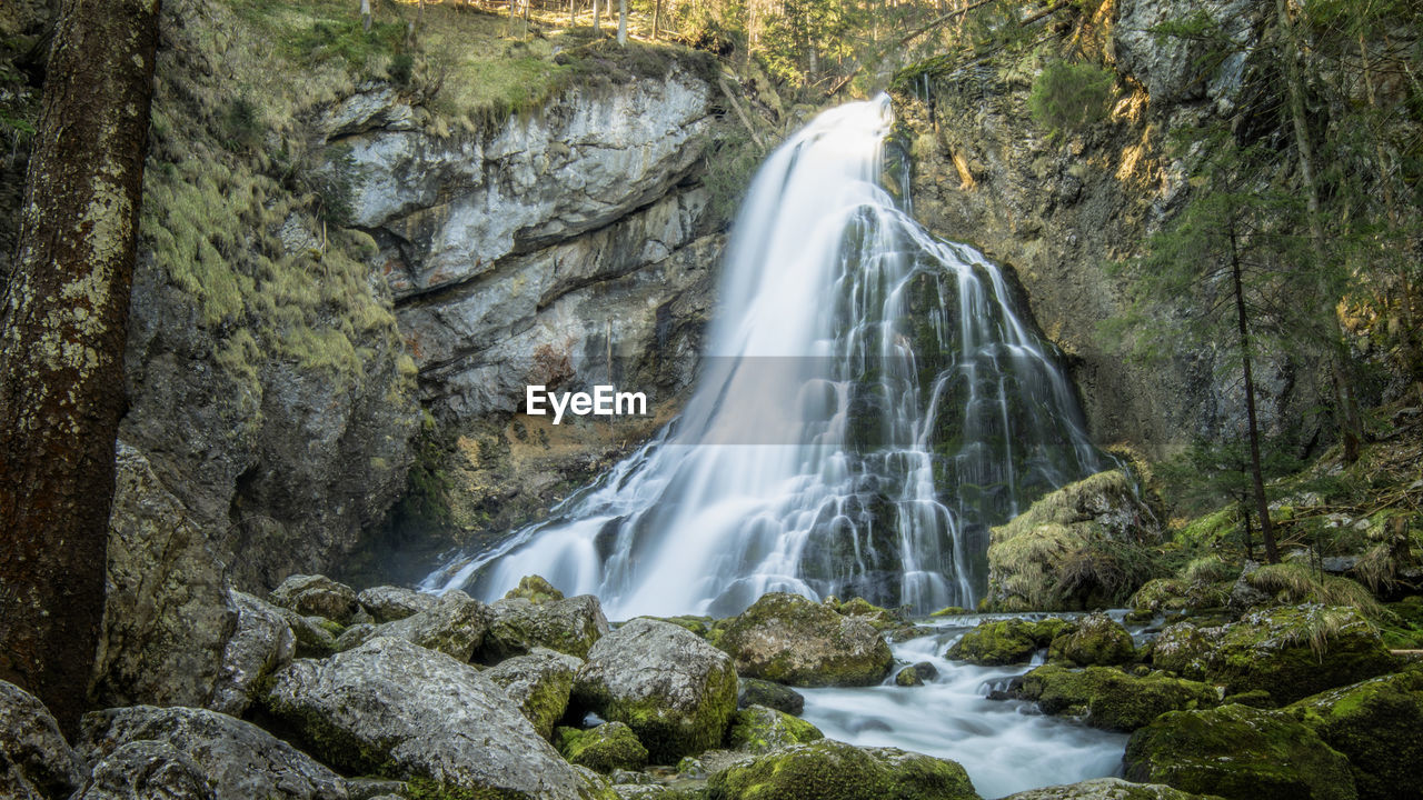 scenics - nature, waterfall, rock, long exposure, rock - object, tree, forest, beauty in nature, solid, flowing water, water, rock formation, land, environment, motion, plant, no people, nature, blurred motion, flowing, outdoors, rainforest, power in nature, falling water