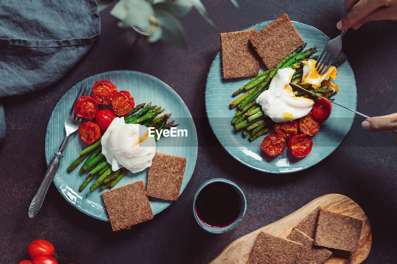 food, food and drink, freshness, healthy eating, ready-to-eat, table, wellbeing, fruit, plate, bread, vegetable, tomato, high angle view, indoors, real people, meal, sandwich, one person, serving size, snack, breakfast