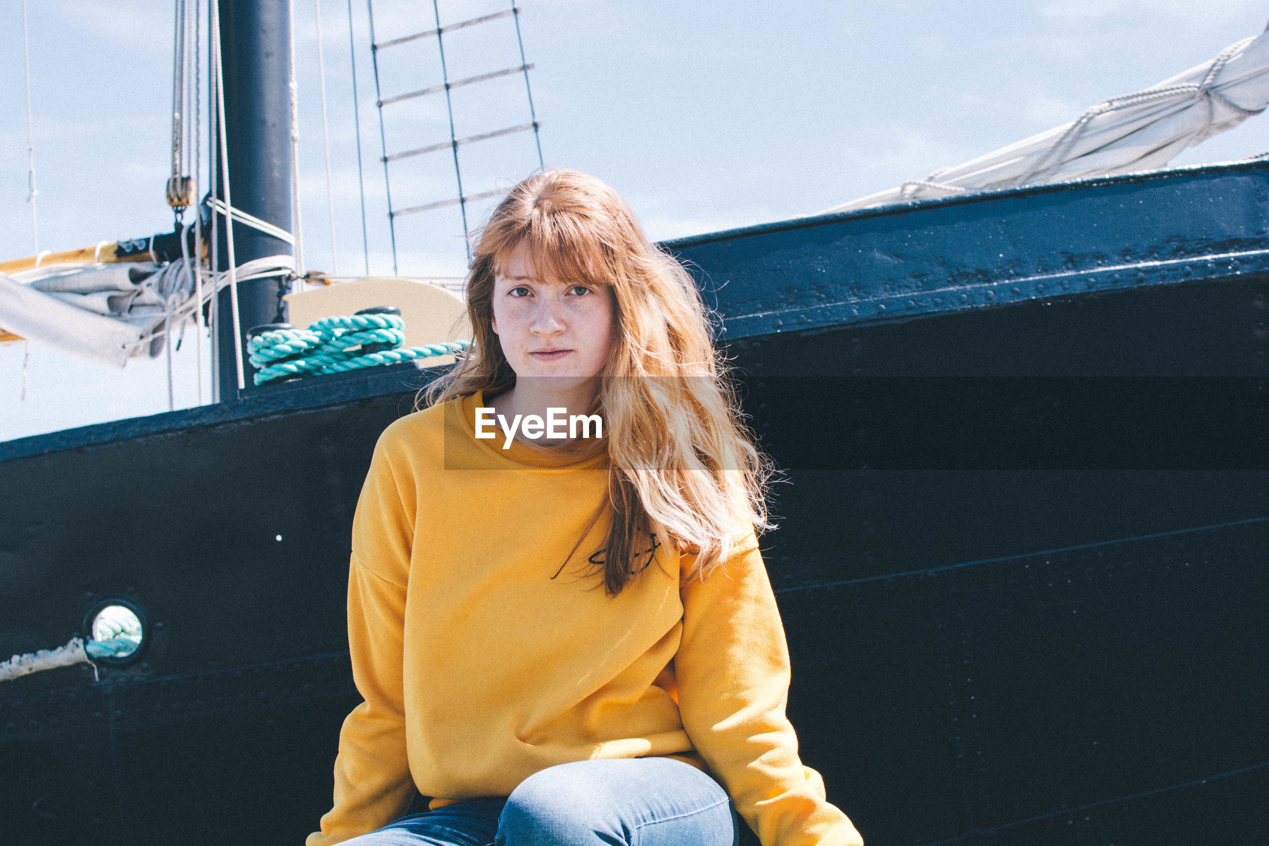 Portrait of smiling woman sitting on boat