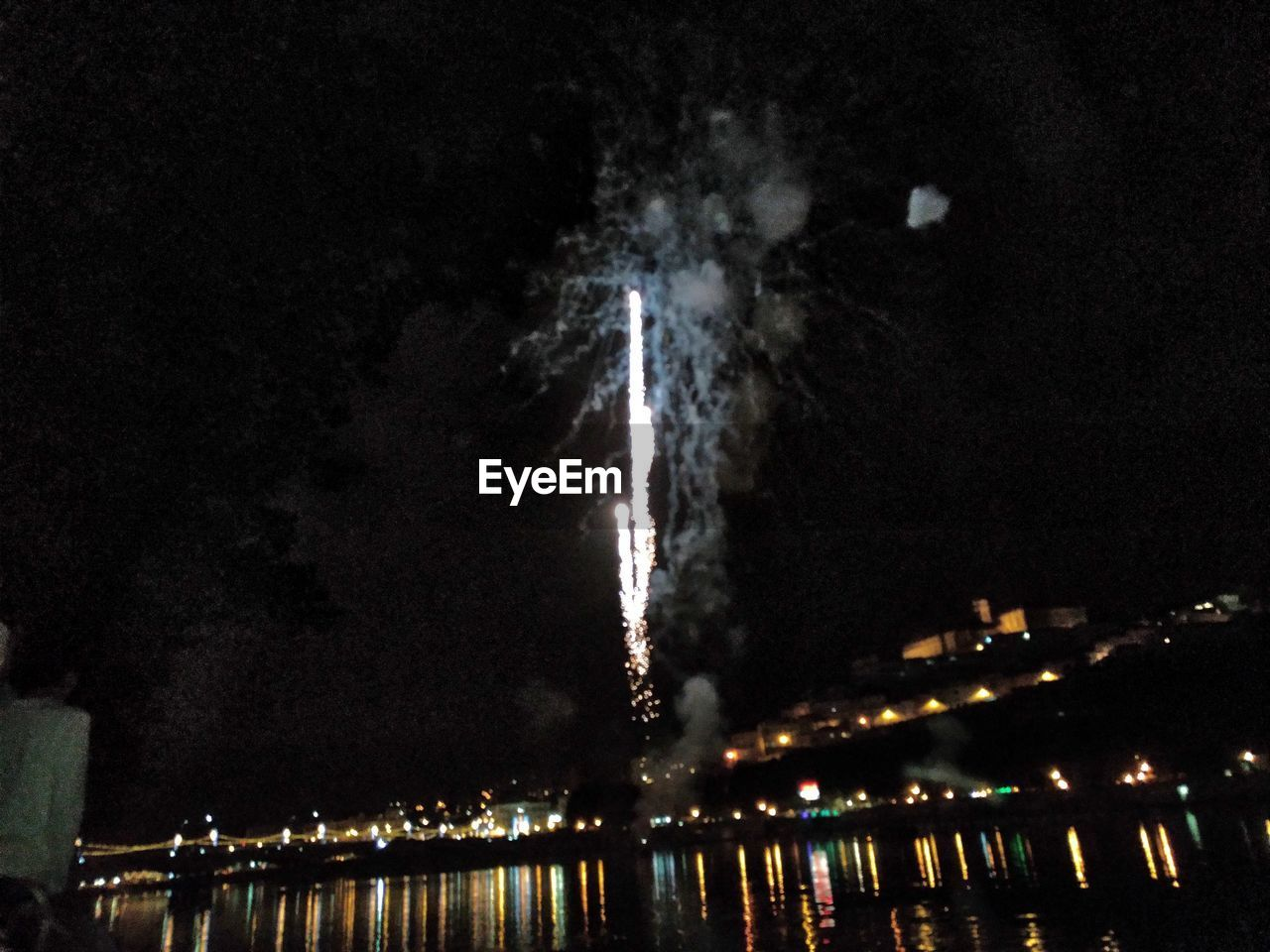 night, illuminated, water, architecture, building exterior, built structure, sky, city, nature, motion, no people, exploding, long exposure, firework, glowing, firework display, river, outdoors, reflection, cityscape, pollution, skyscraper