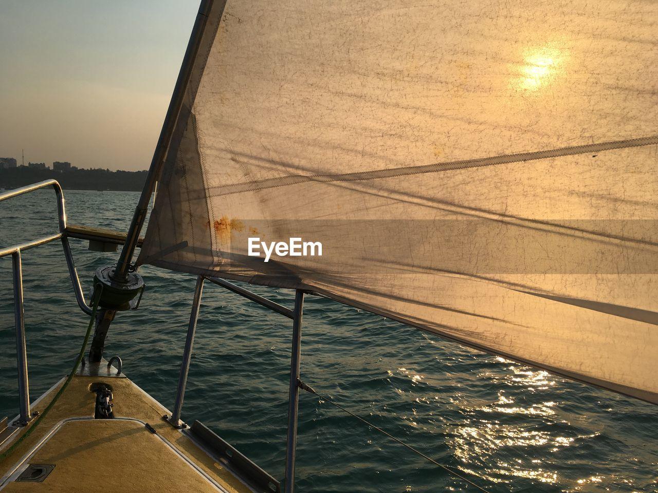 Sailboat Sailing On Sea At Sunset