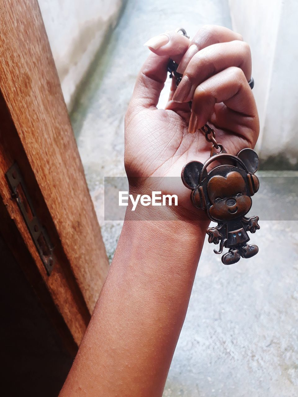 human hand, hand, holding, real people, one person, human body part, focus on foreground, high angle view, day, close-up, lifestyles, leisure activity, personal perspective, body part, outdoors, adult, metal, activity, unrecognizable person, finger