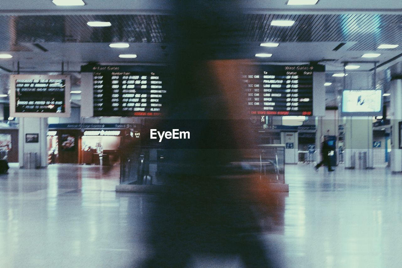 Blurred motion of people at airport