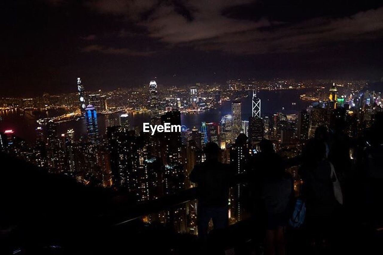 cityscape, skyscraper, city, night, illuminated, architecture, travel destinations, building exterior, crowded, modern, city life, urban skyline, downtown district, outdoors, sky, people